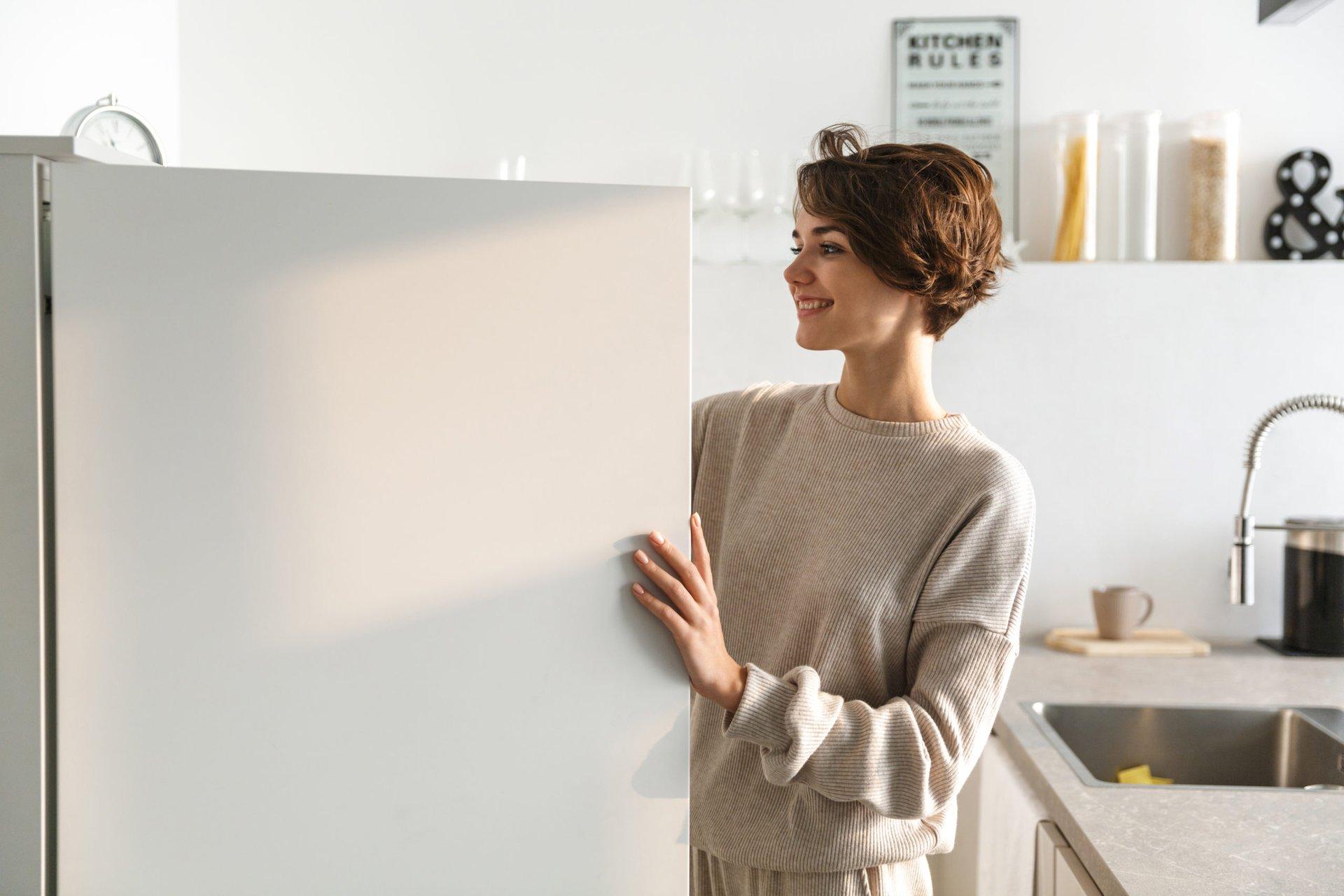 woman opening a freezer