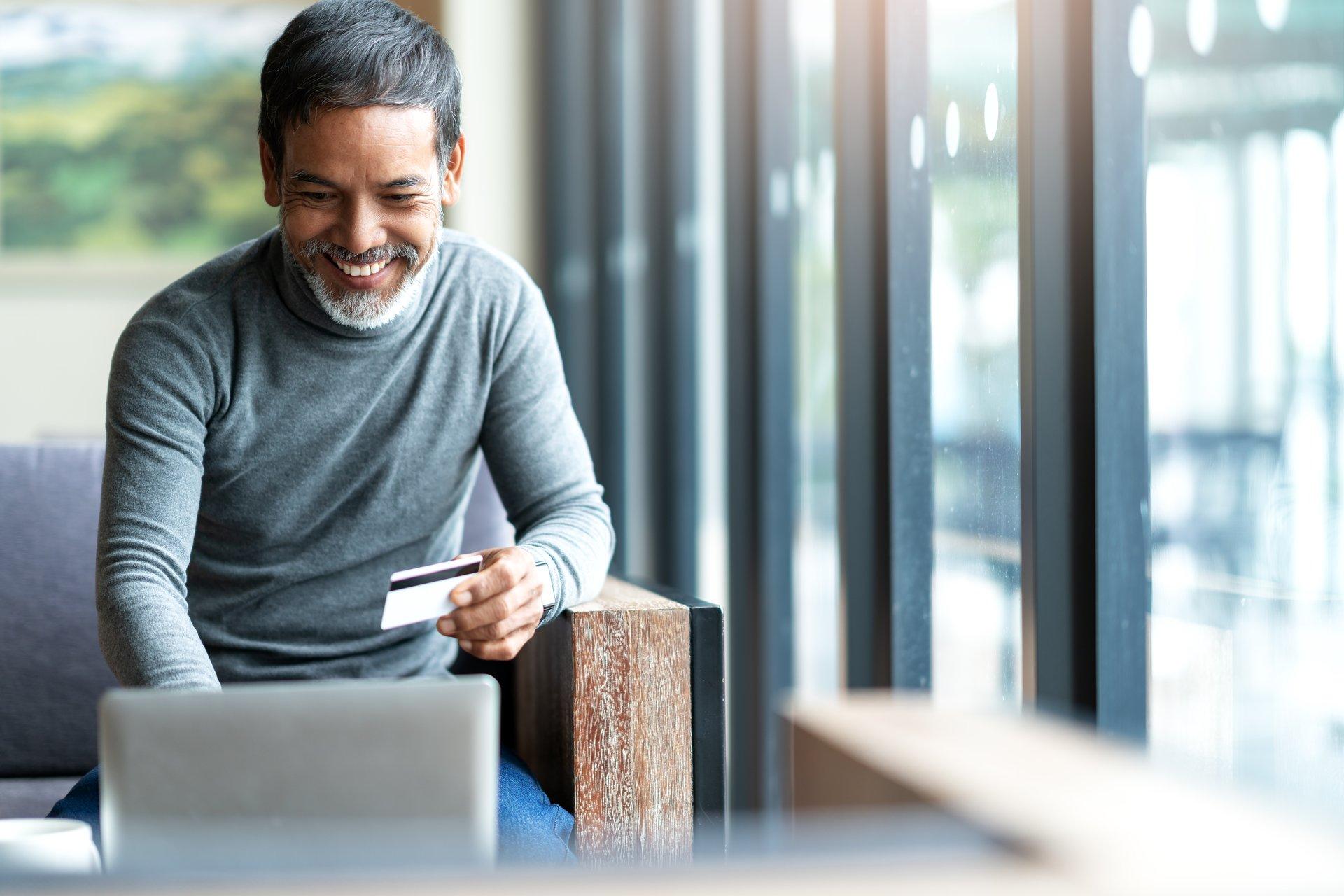 bearded hispanic asian senior man computer credit card