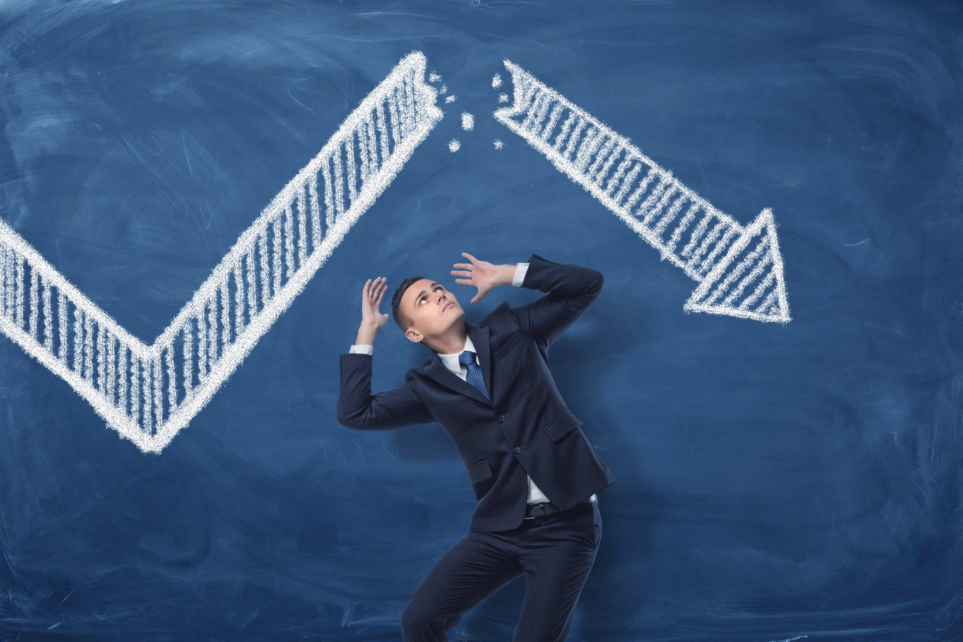 An investor panics over a market crash