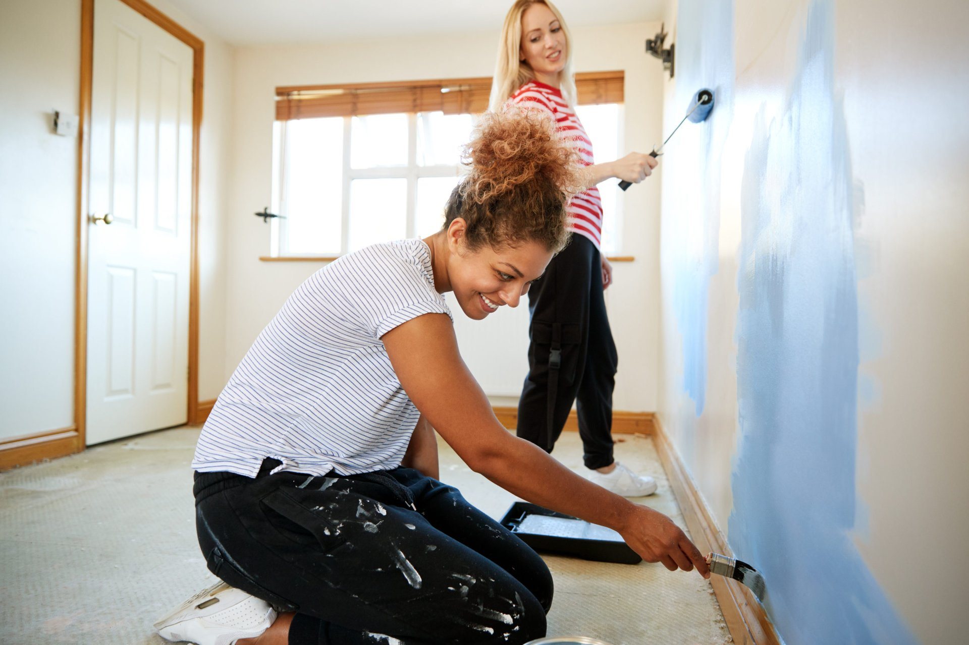 Women painting a home