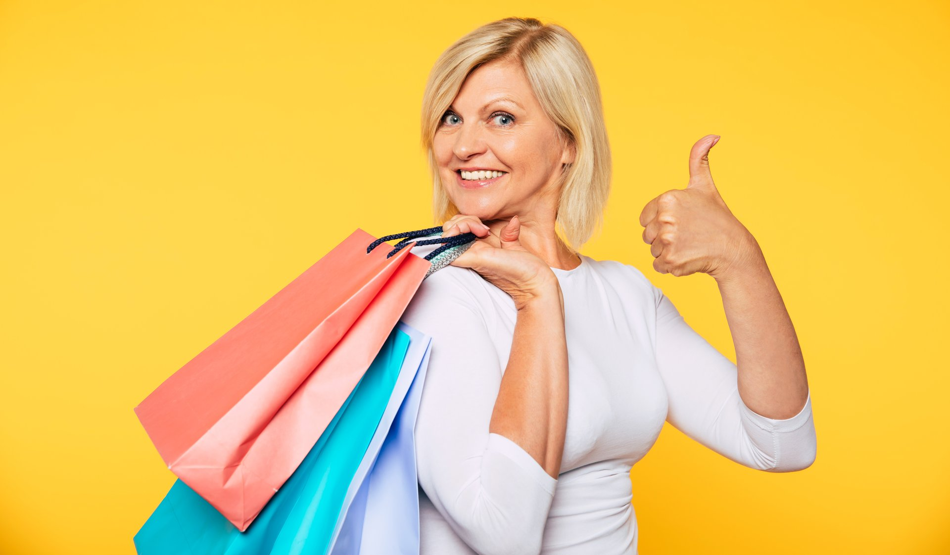 Woman shopping gives thumbs up