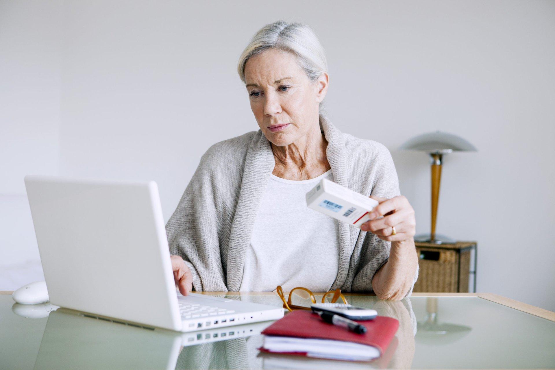 Woman ordering prescription drugs online