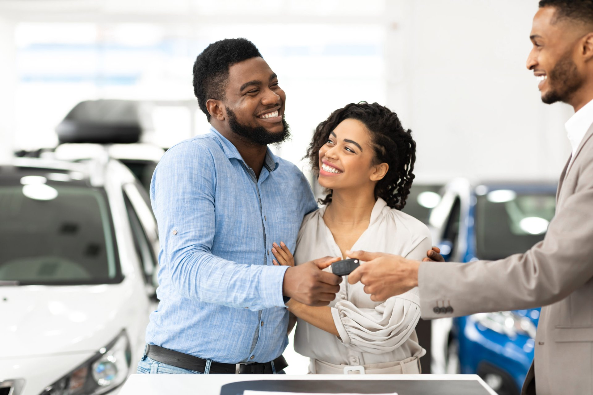 Couple buying a new car at a dealership