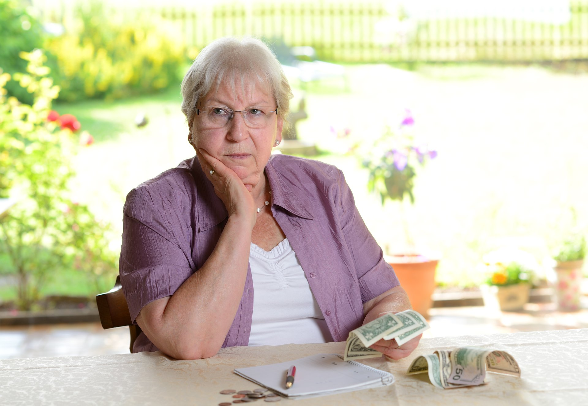 Older woman counting money