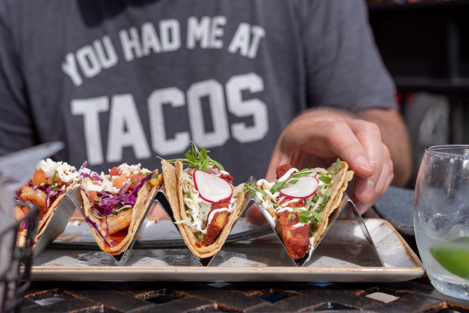 Man eating tacos at a restaurant