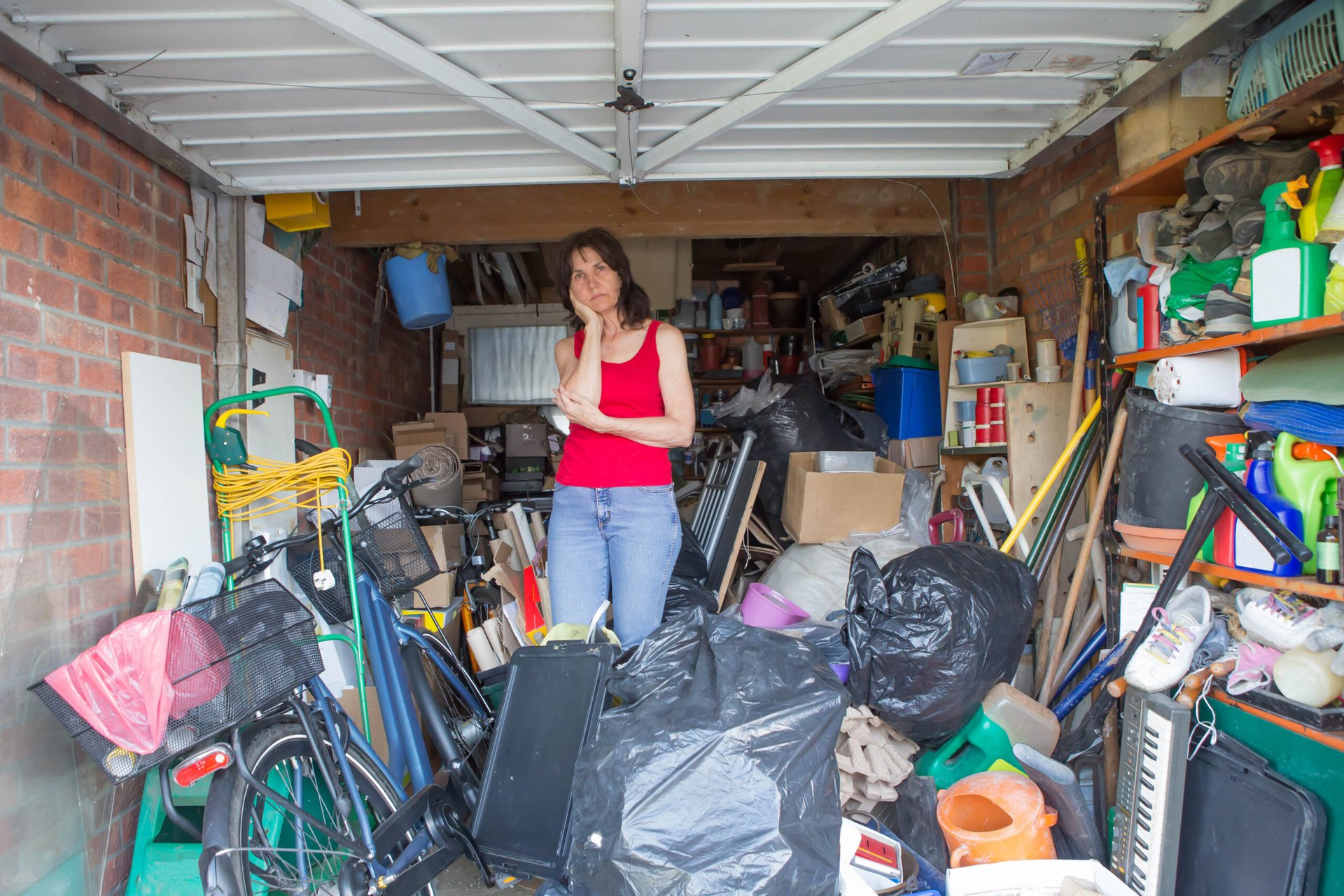 Upset woman in a cluttered garage
