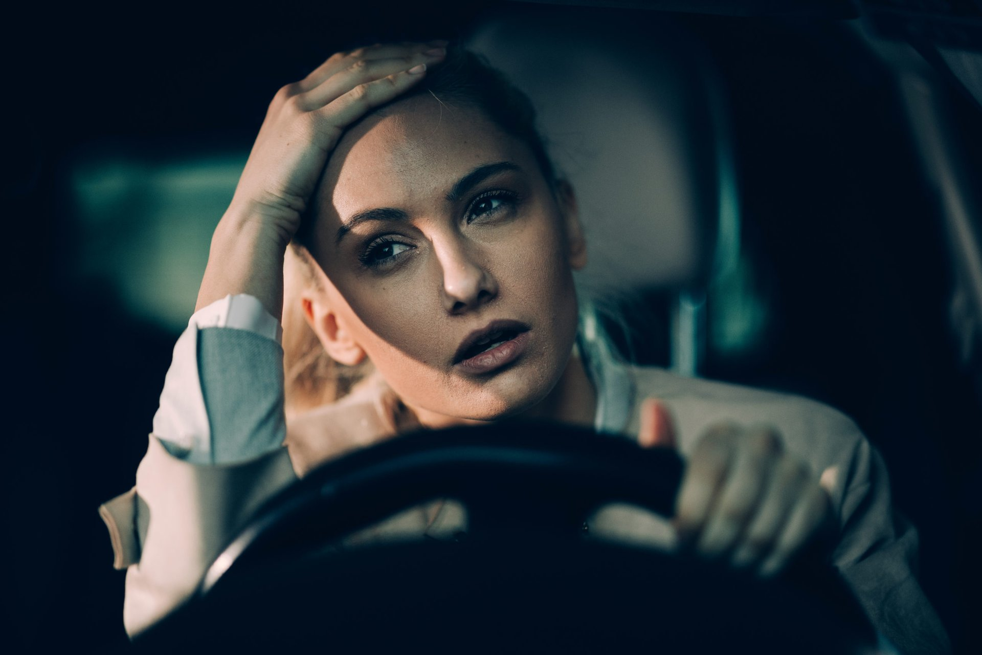 Upset woman driving a car