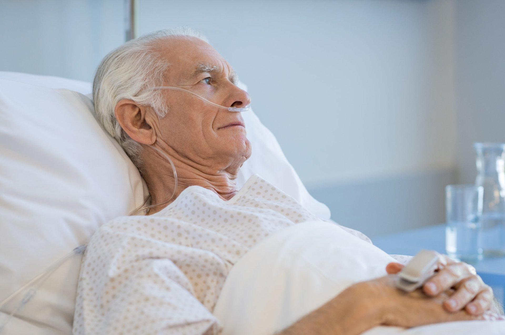 Senior lying in a hospital bed
