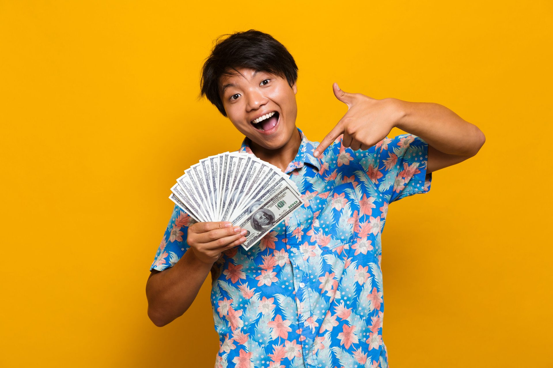 Happy young man with money