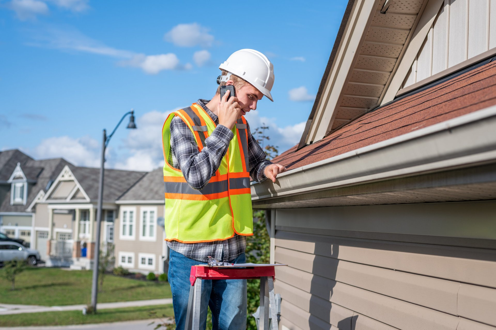 Worker inspecting the roof of a home