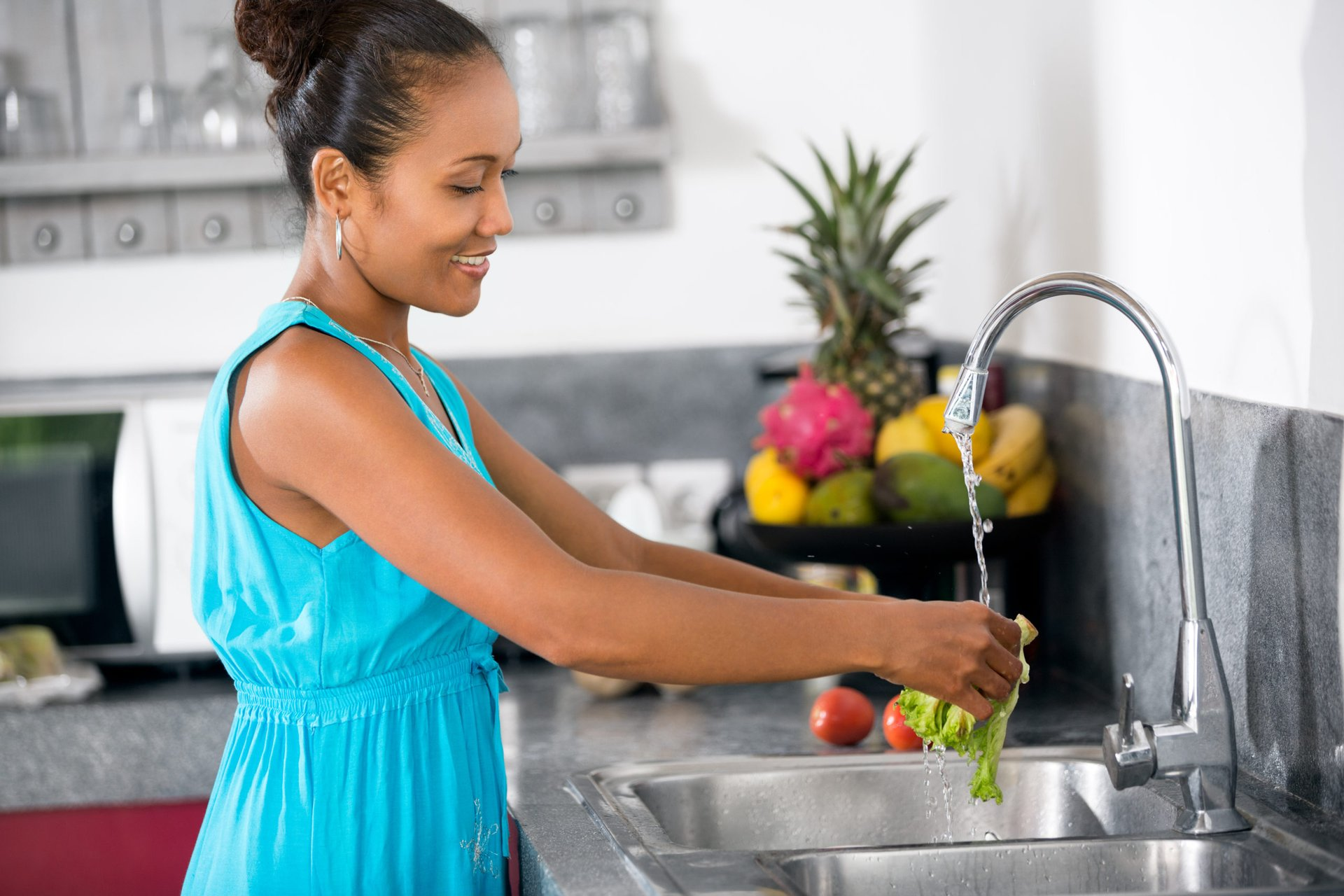 Woman washing produce