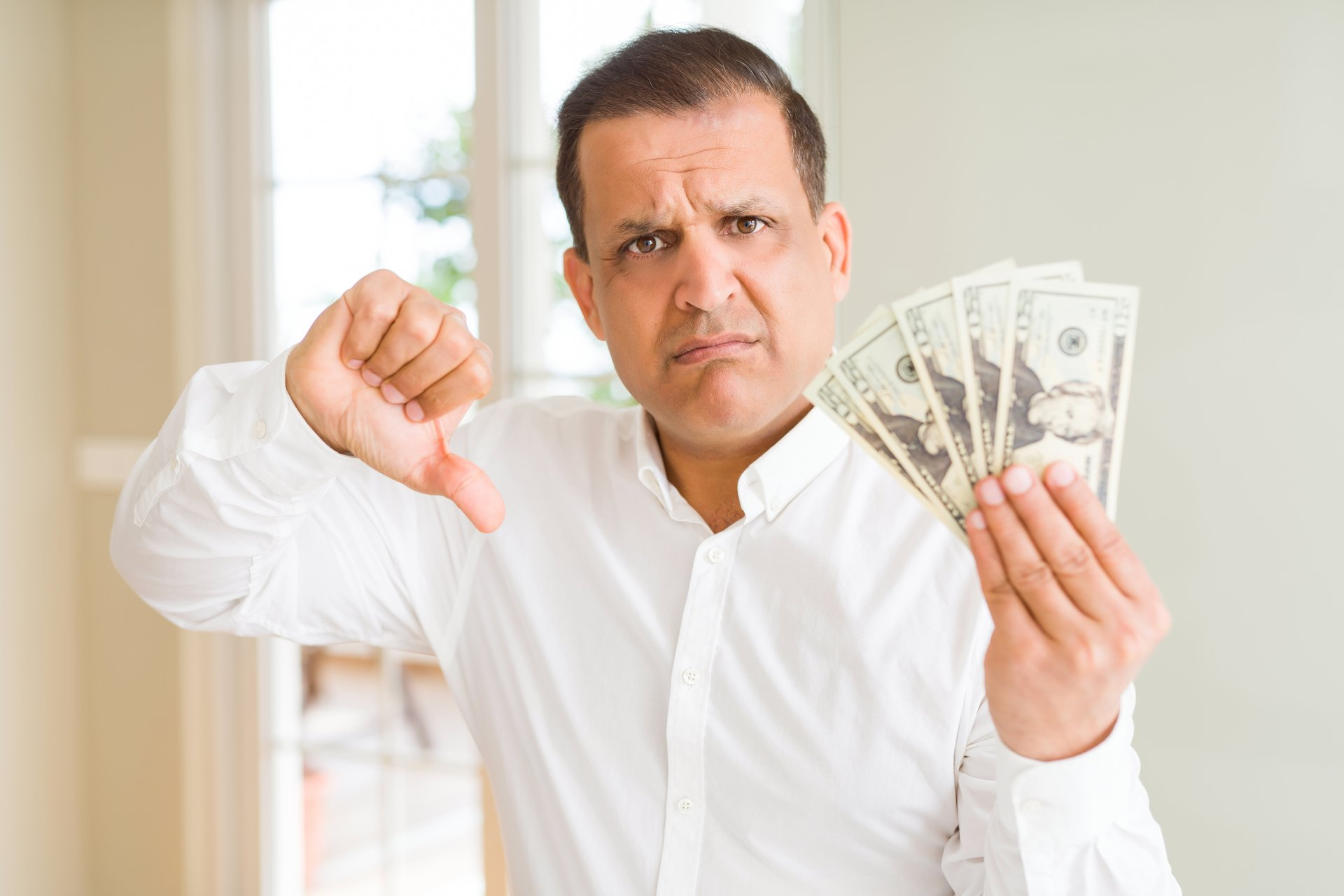 Angry man with money