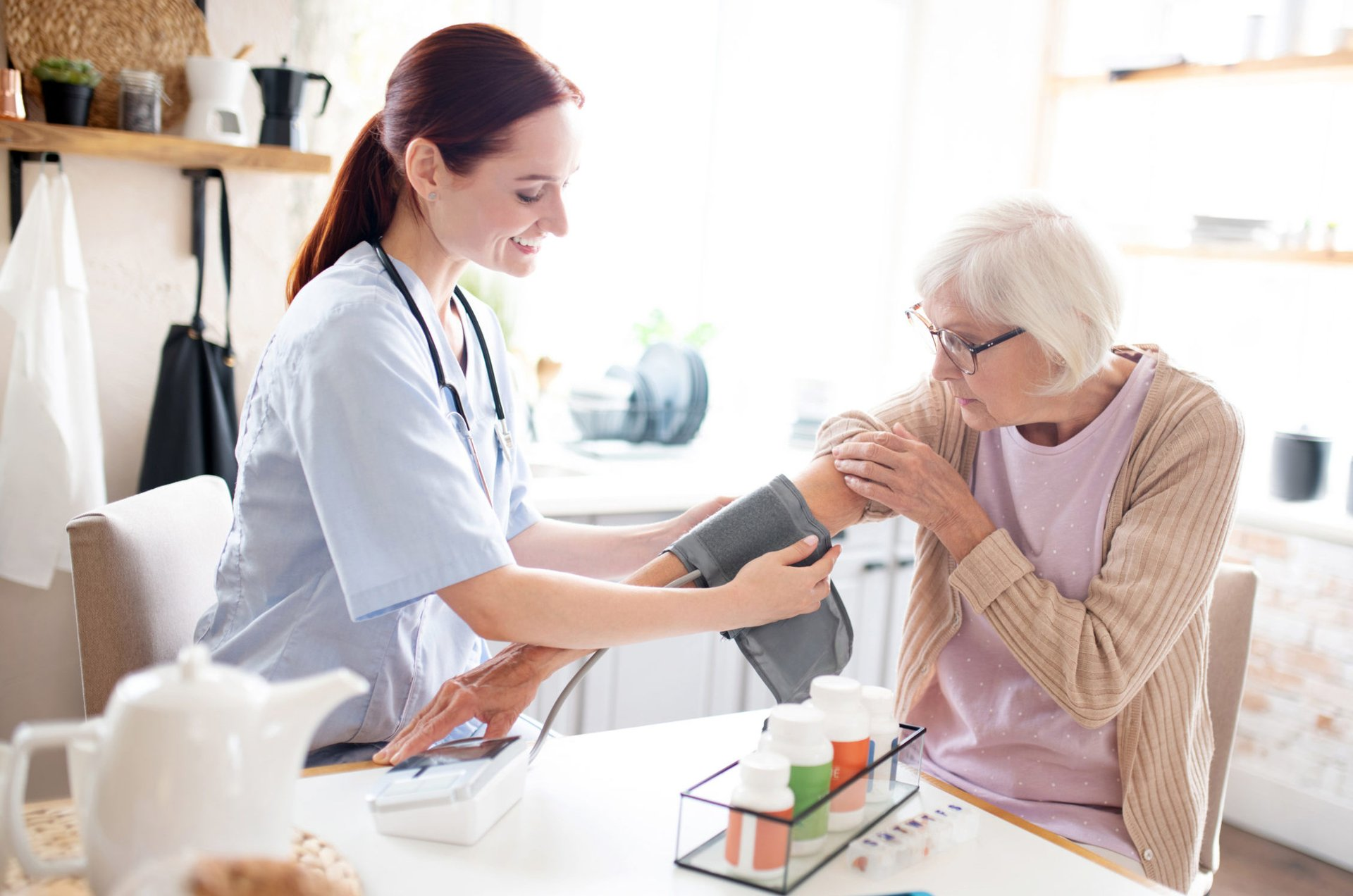 home health nurse taking a senior's blood pressure