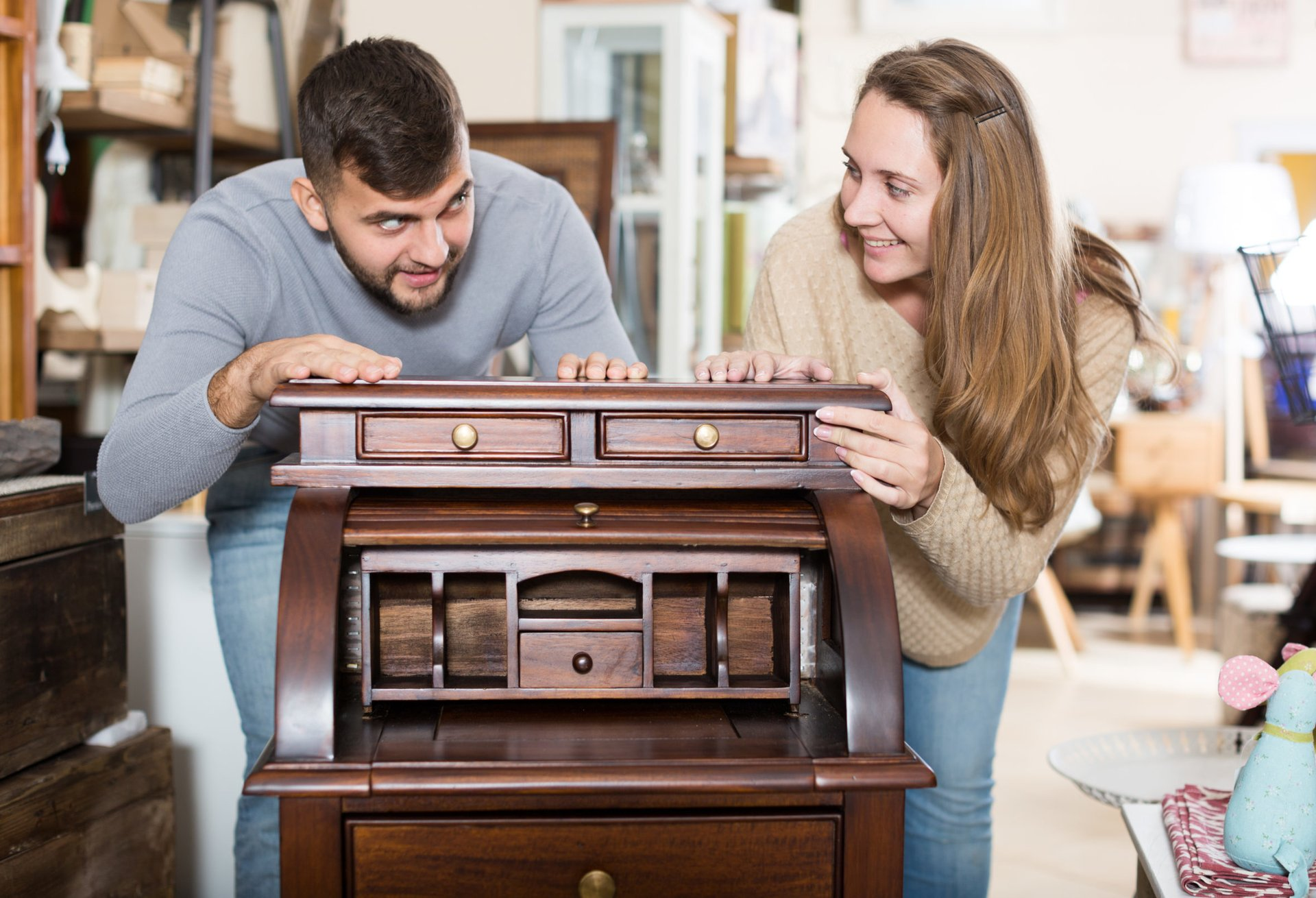Couple shopping for used furniture