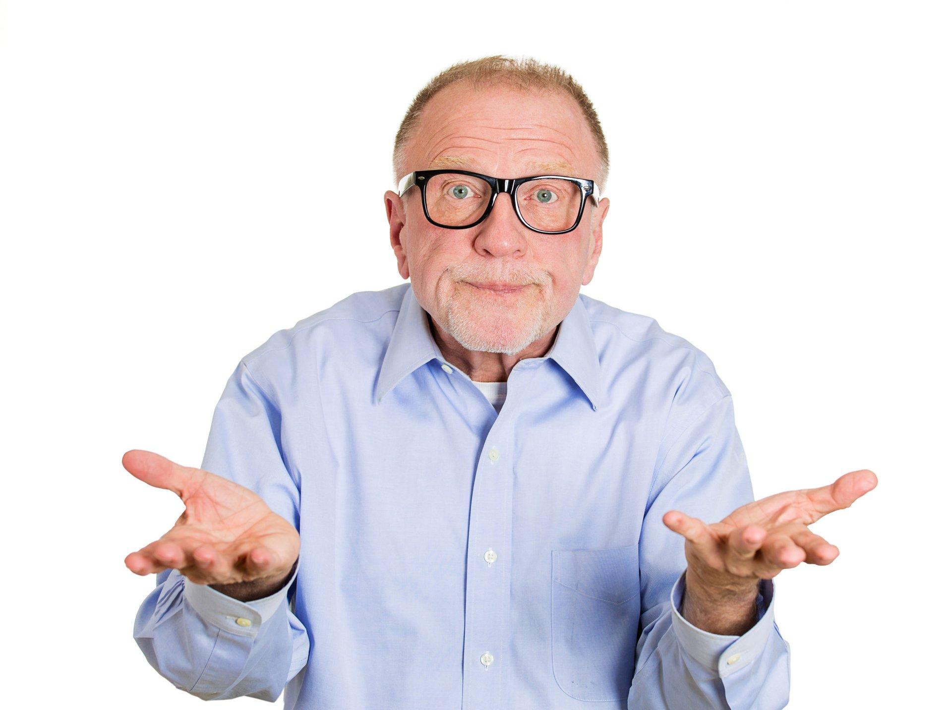 Senior man shrugging