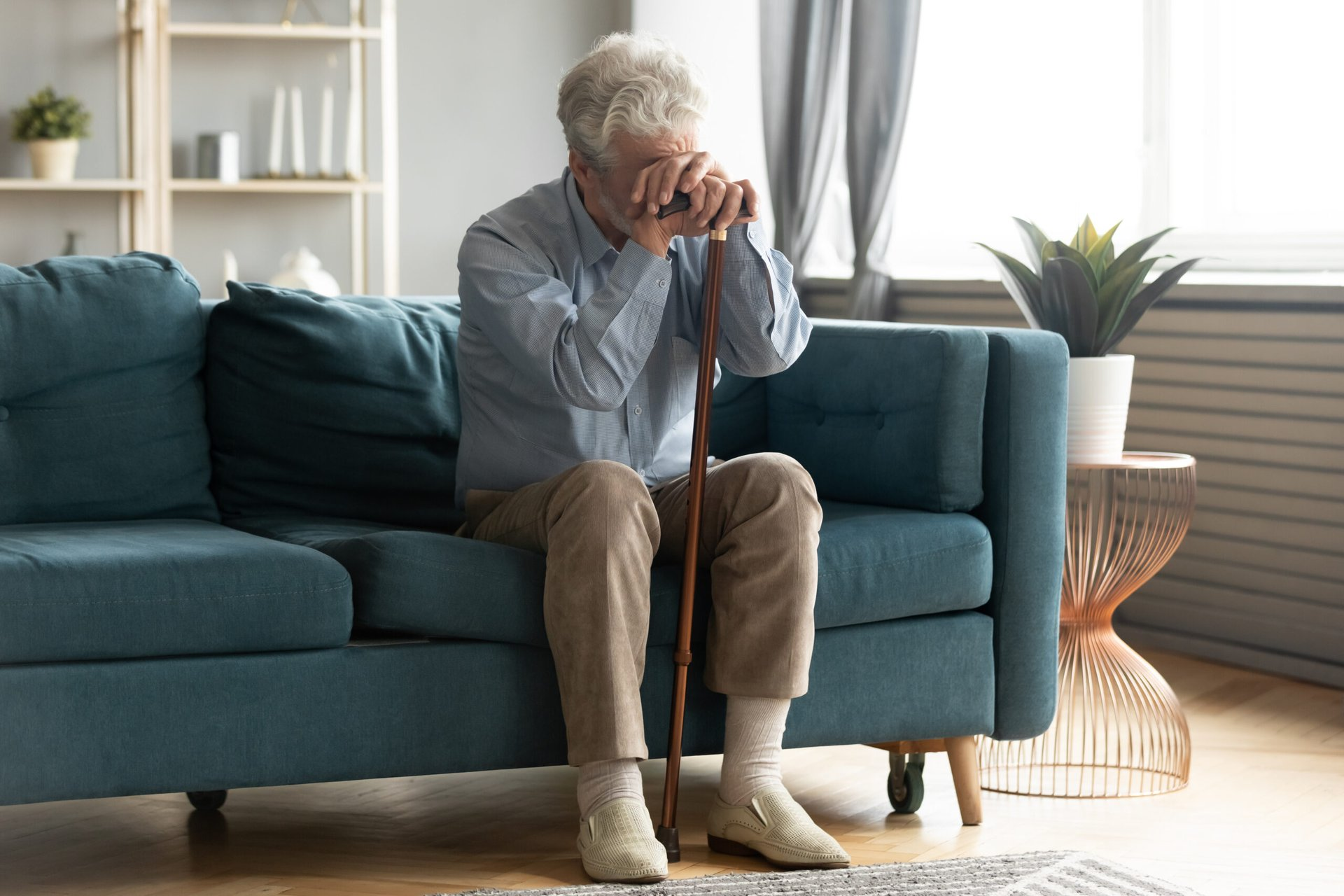 Worried senior holding a cane