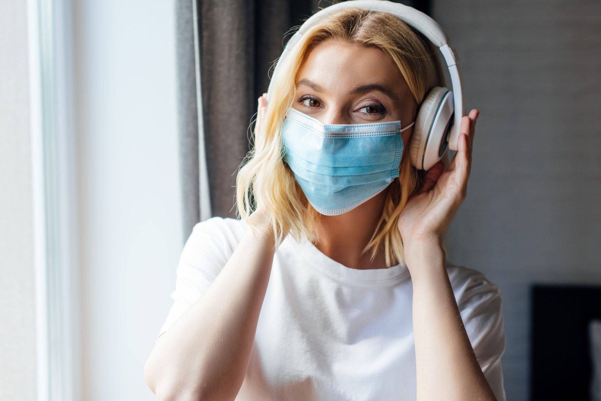 Woman in a mask and headphones