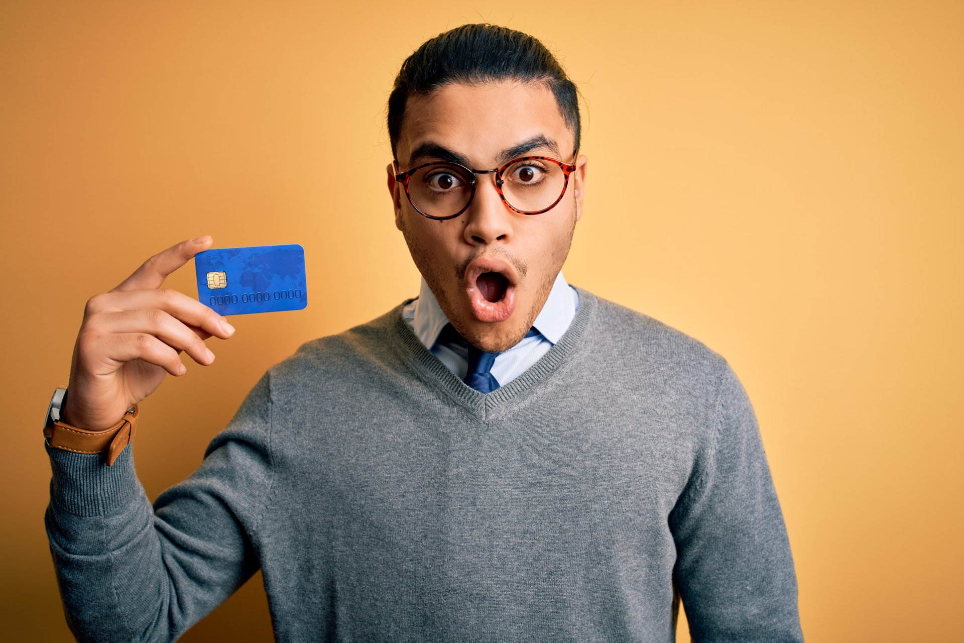 Fearful man with credit card