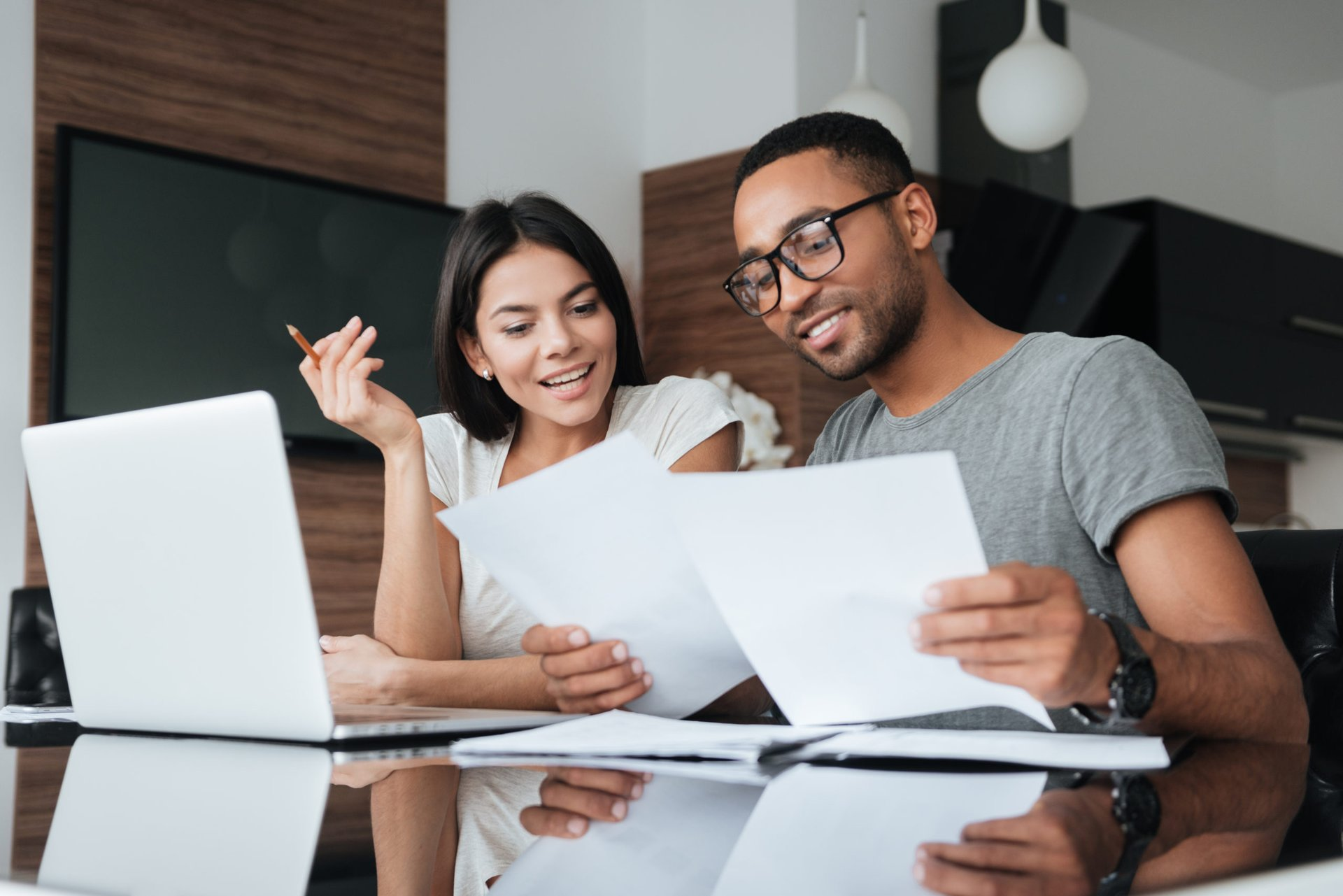 couple improving their finances from home