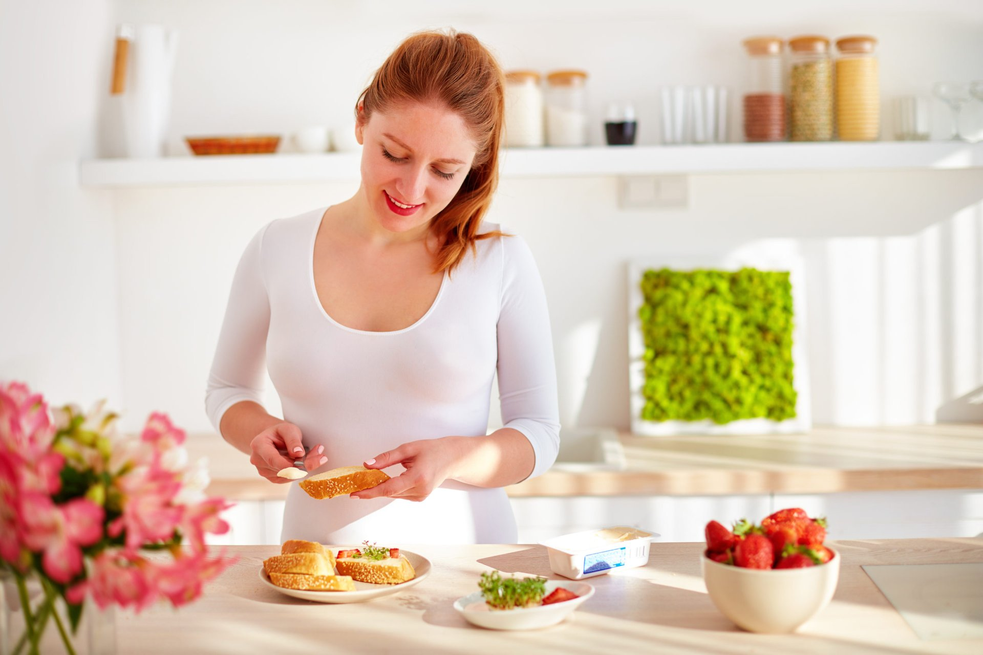 a woman prepares a meal at home