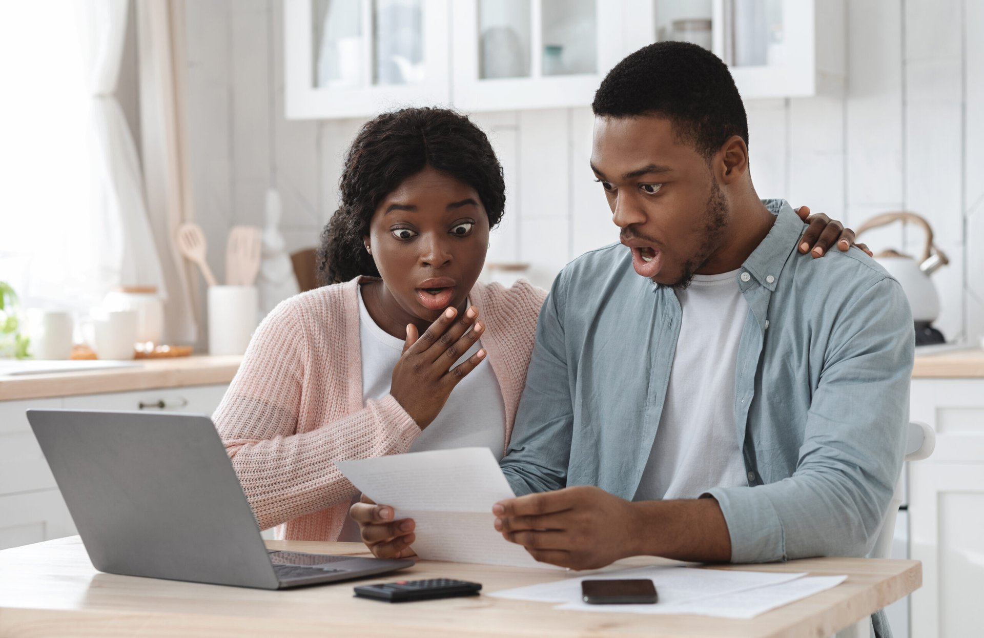 Shocked couple in debt
