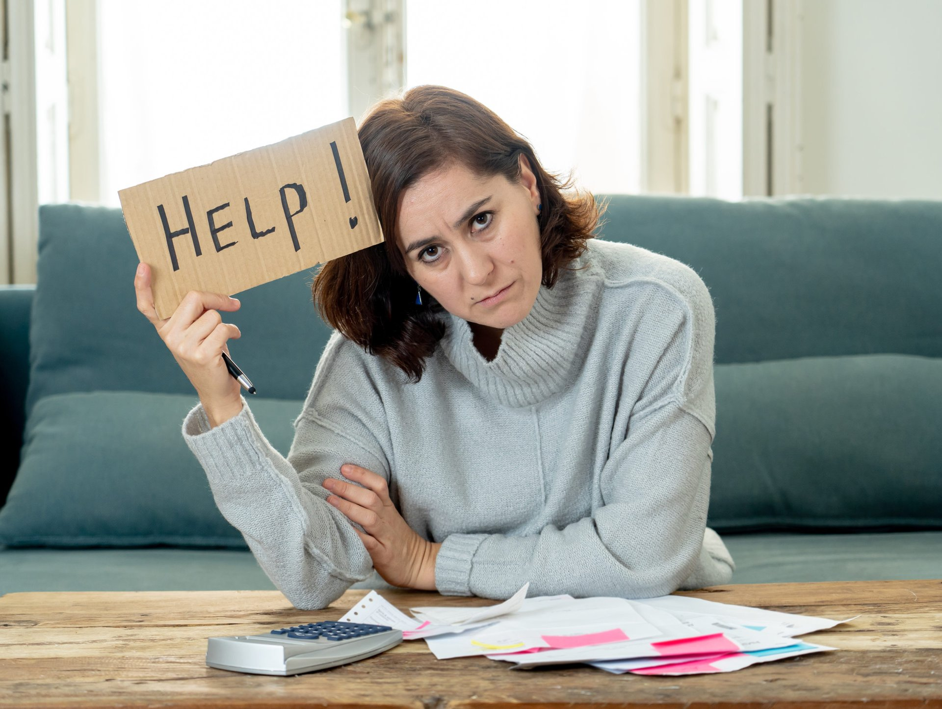 Woman with Bills, Help Sign