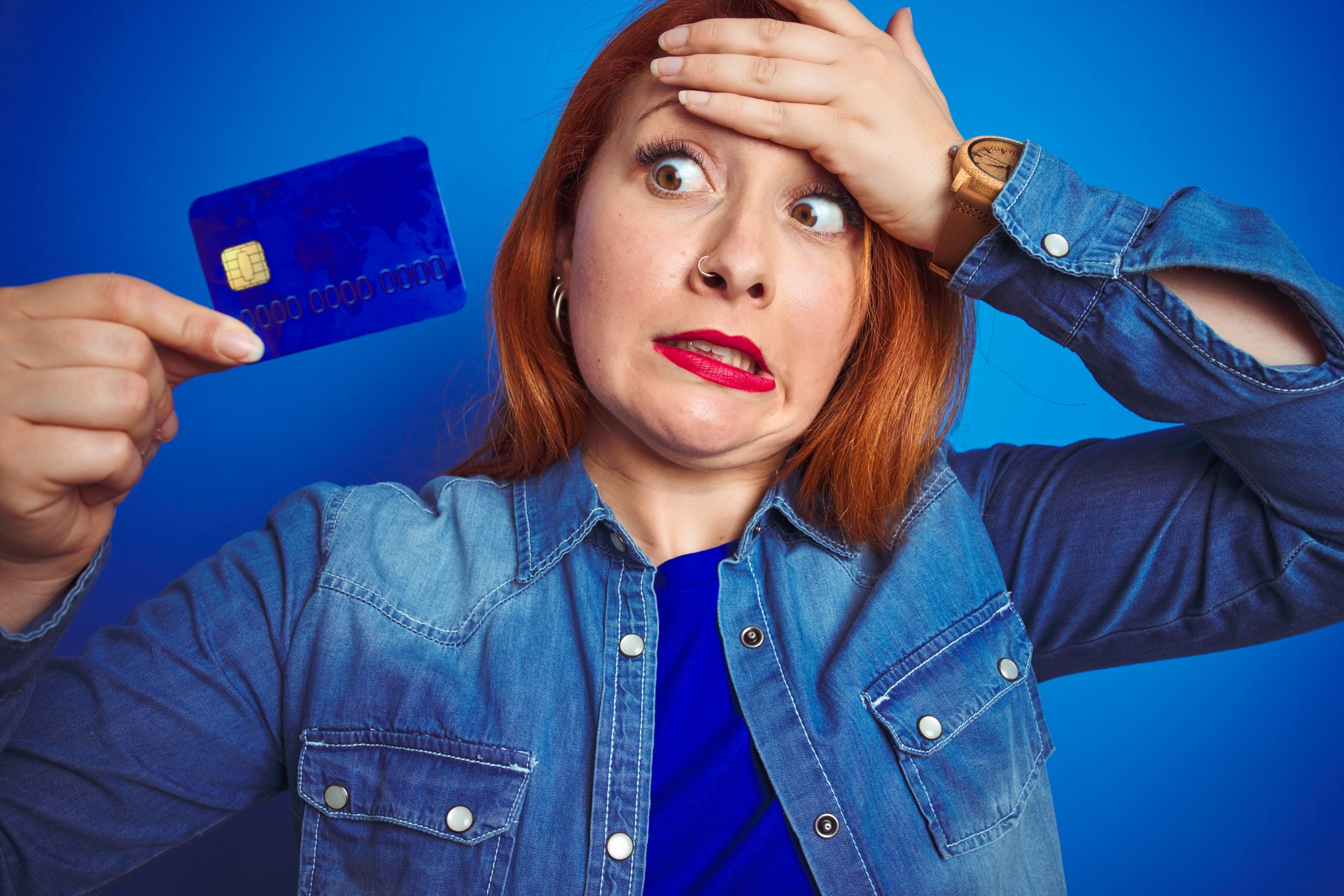 Upset woman with credit card
