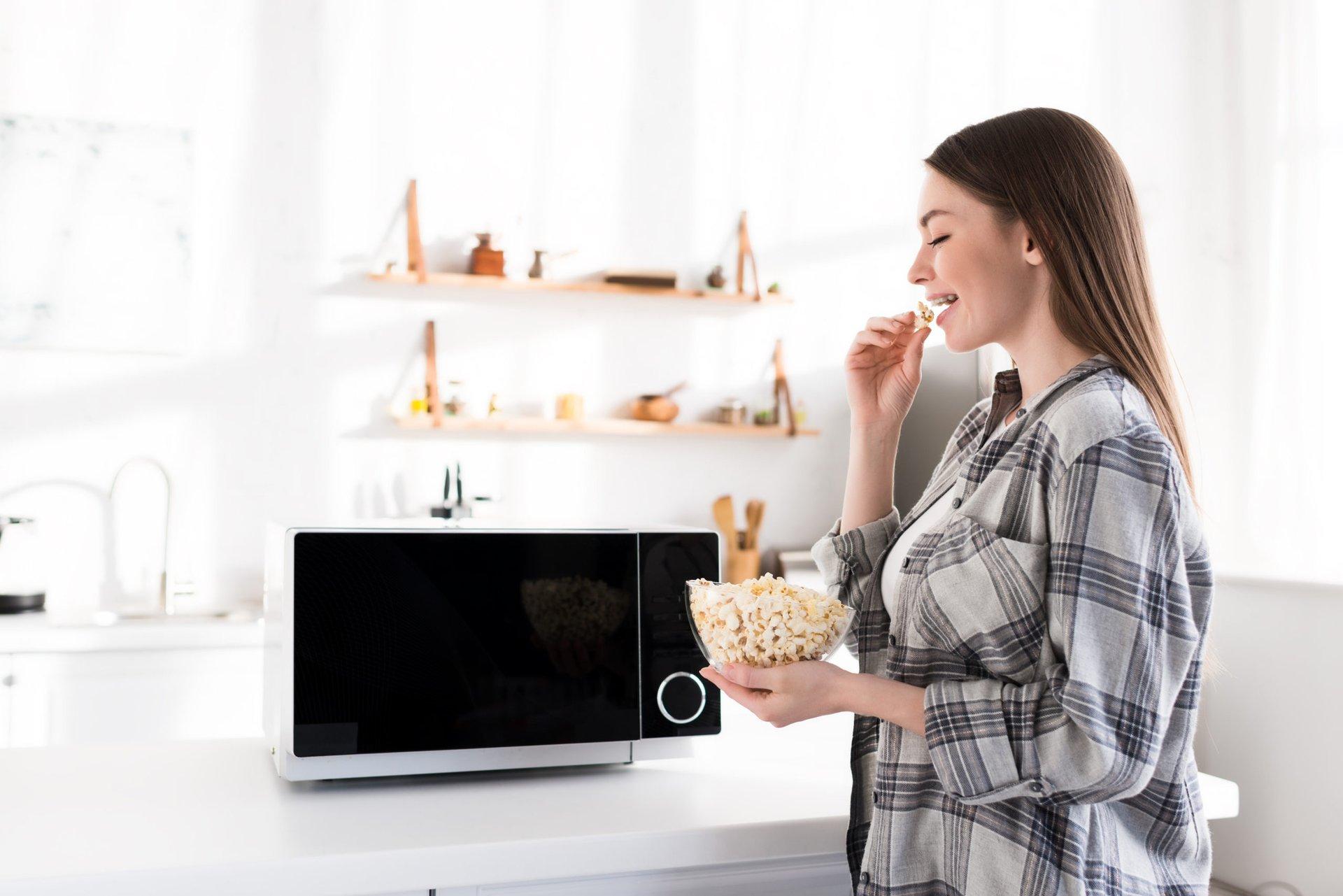 Eating microwave popcorn