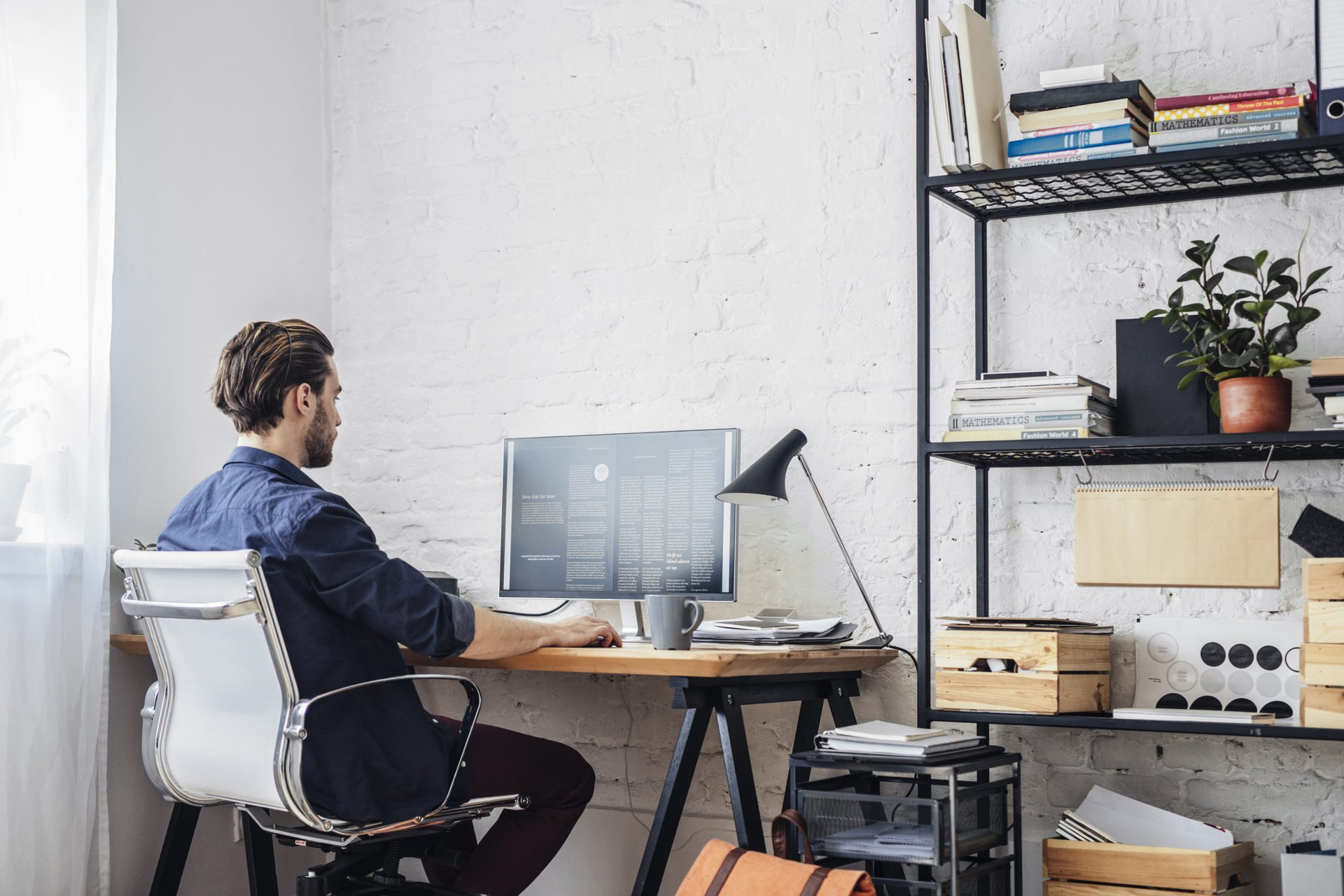 Young man working job from home at his desk
