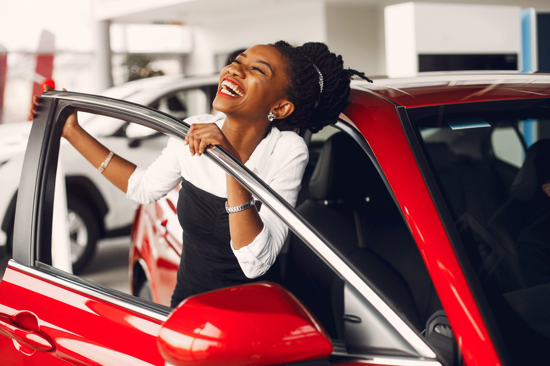 Happy woman with new car
