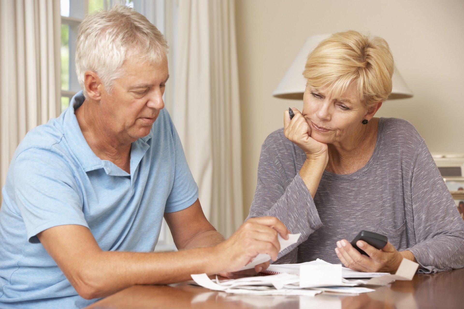 Senior couple examining their finances