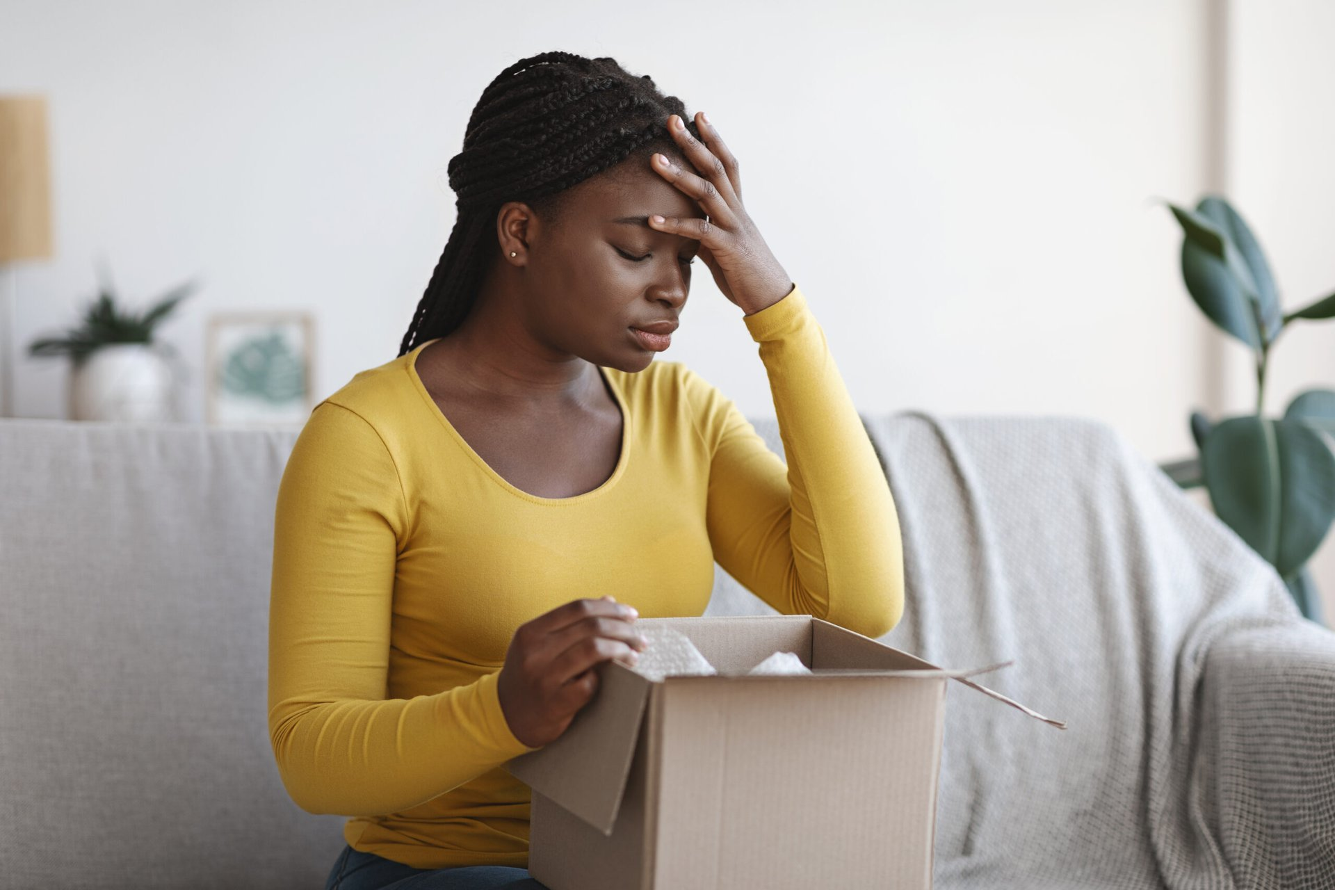 Upset woman with a package