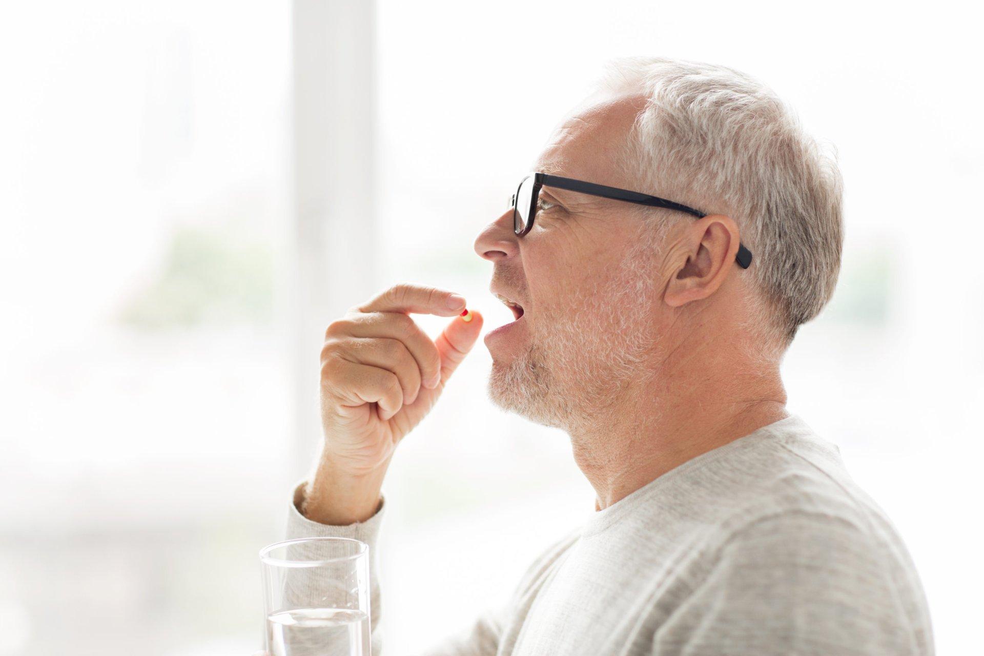 Man taking a daily aspirin