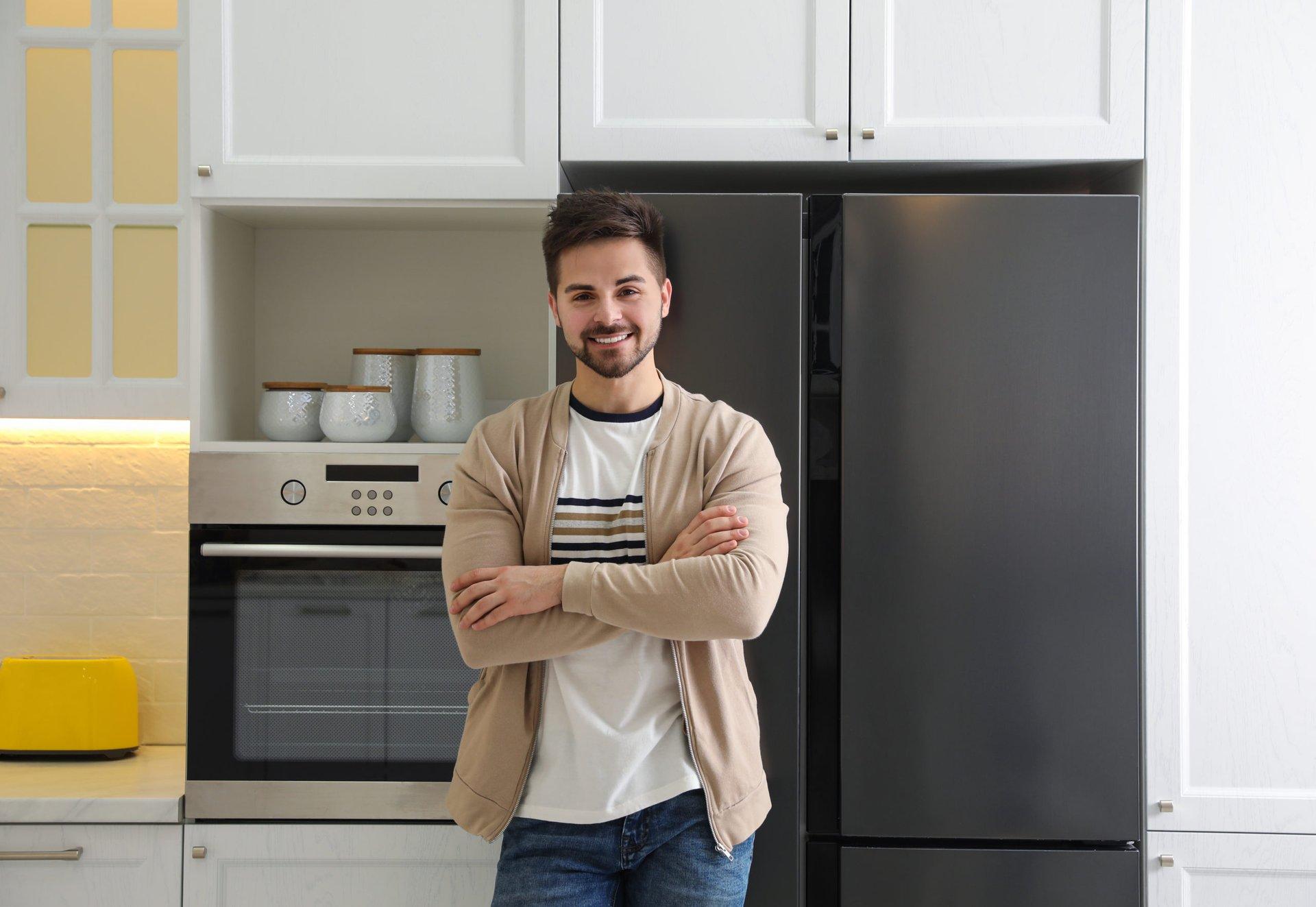 happy man with refrigerator