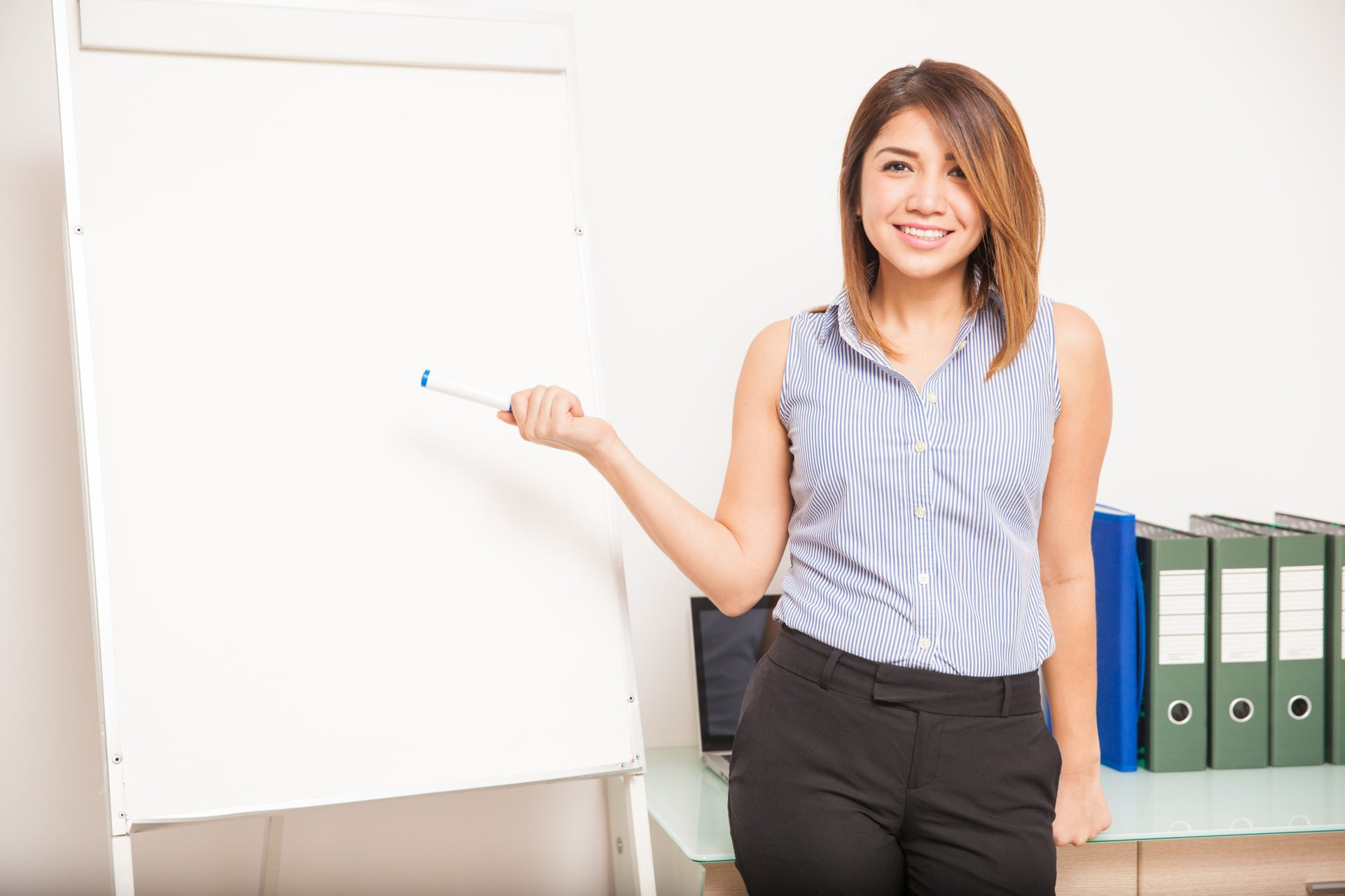 woman using a whiteboard