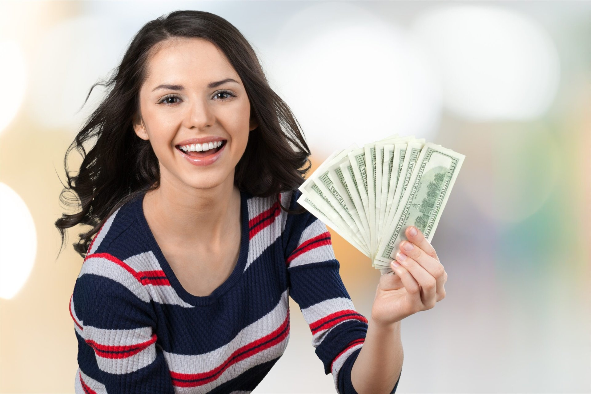 Young woman with money