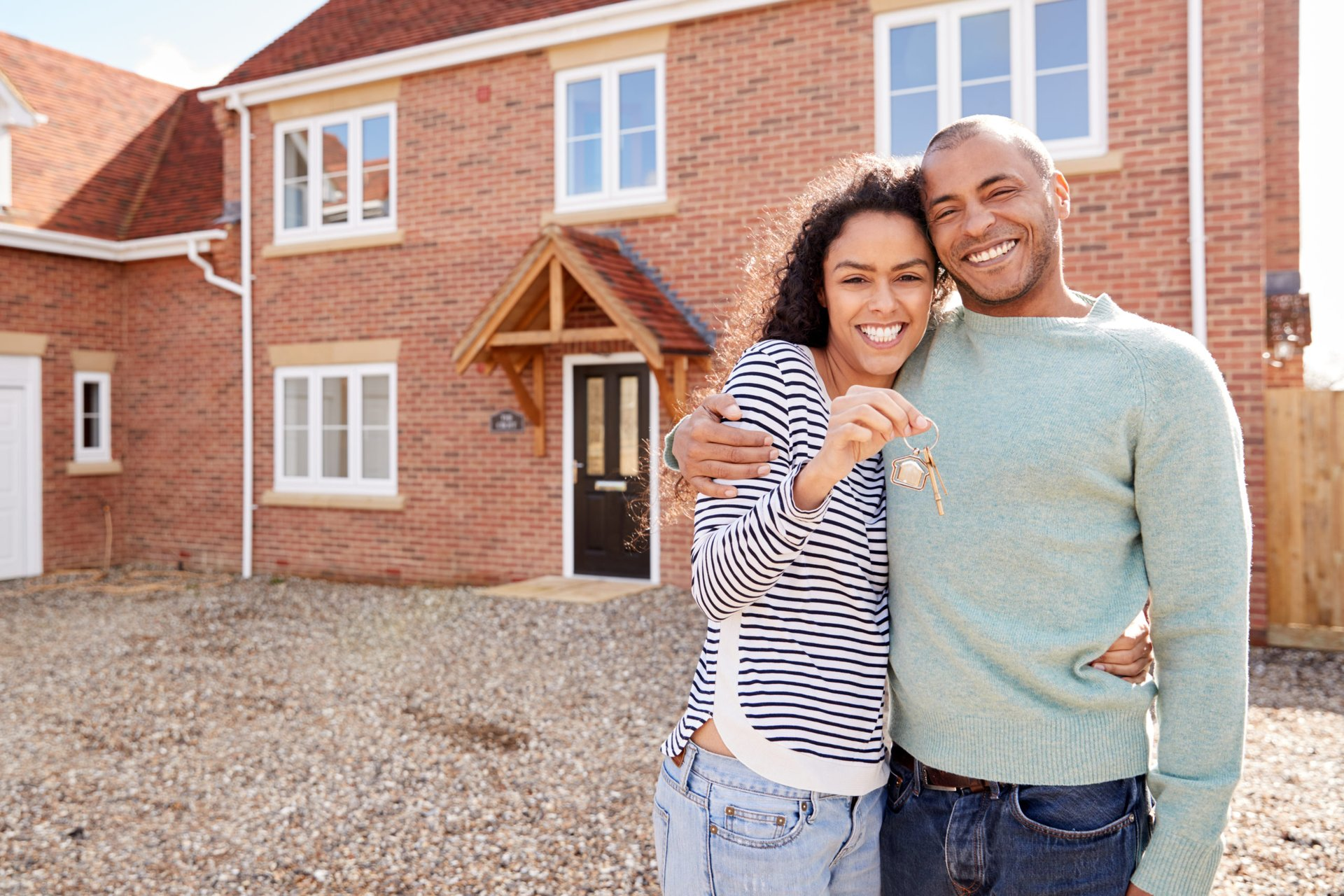 Happy couple buying a home in a new city