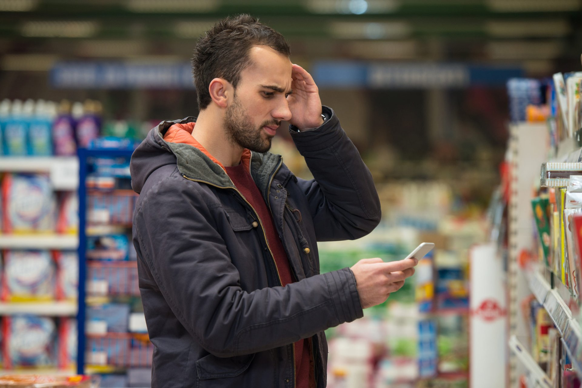 Curious man shopping for groceries