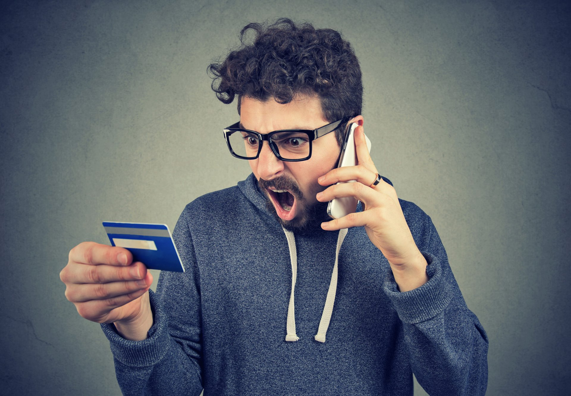 Angry man with credit card