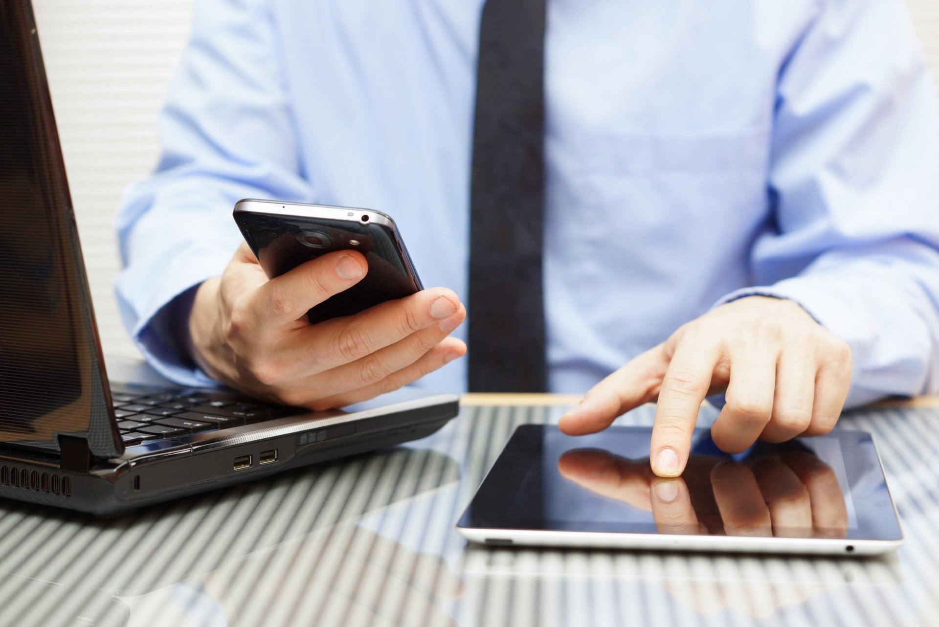 Man using too much data on his phone, tablet and laptop