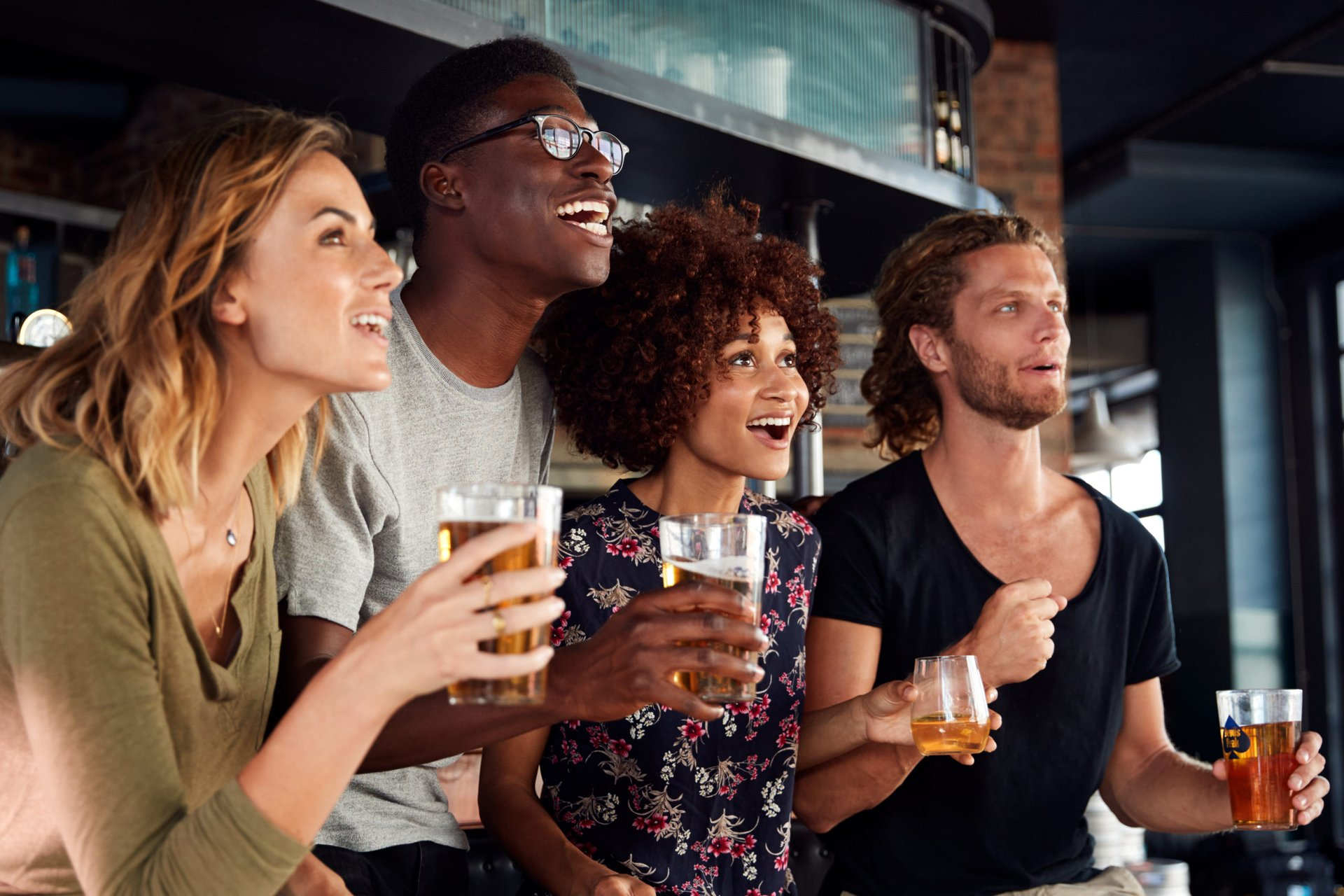 Friends watching a game at a sports bar