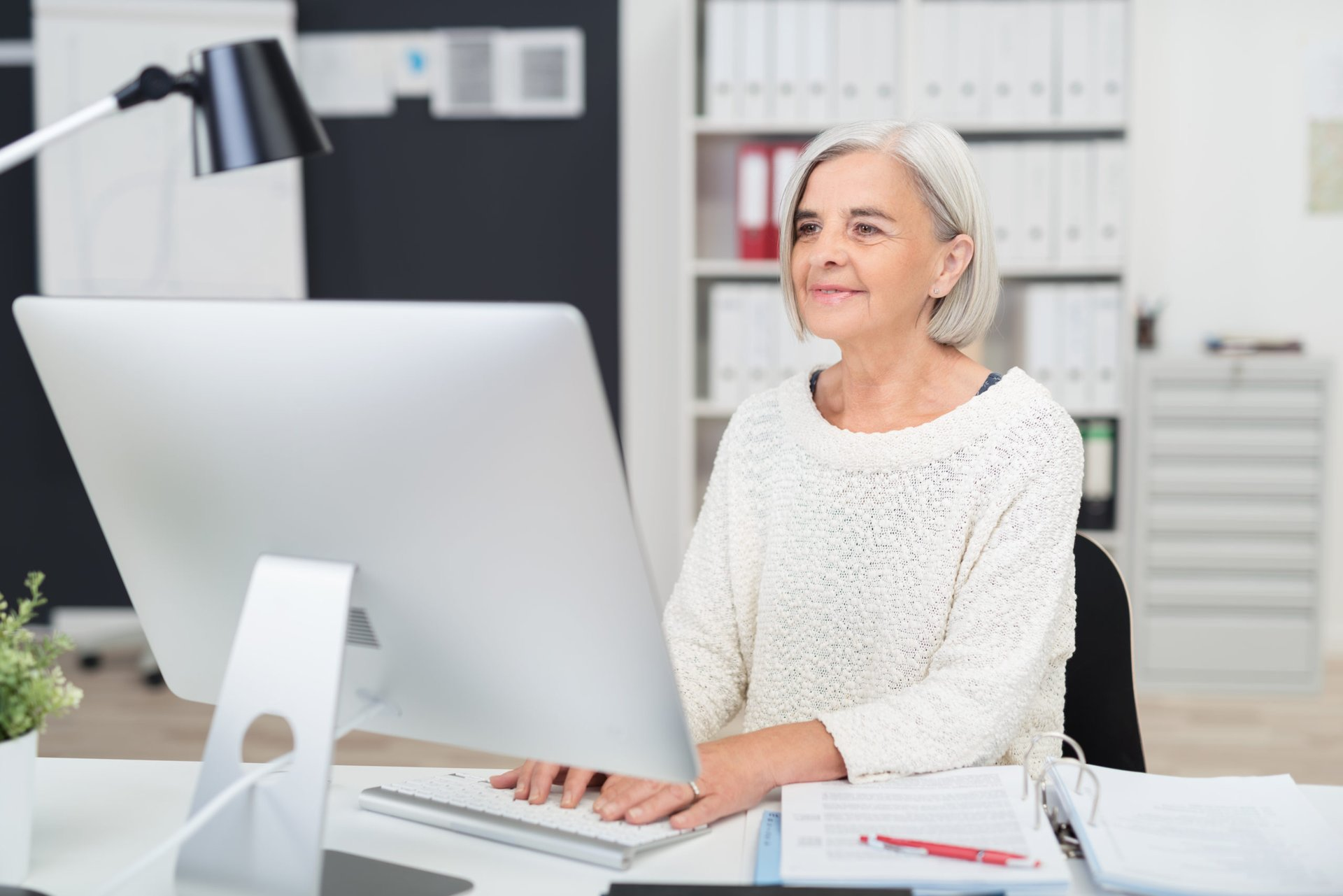 Senior working in an office