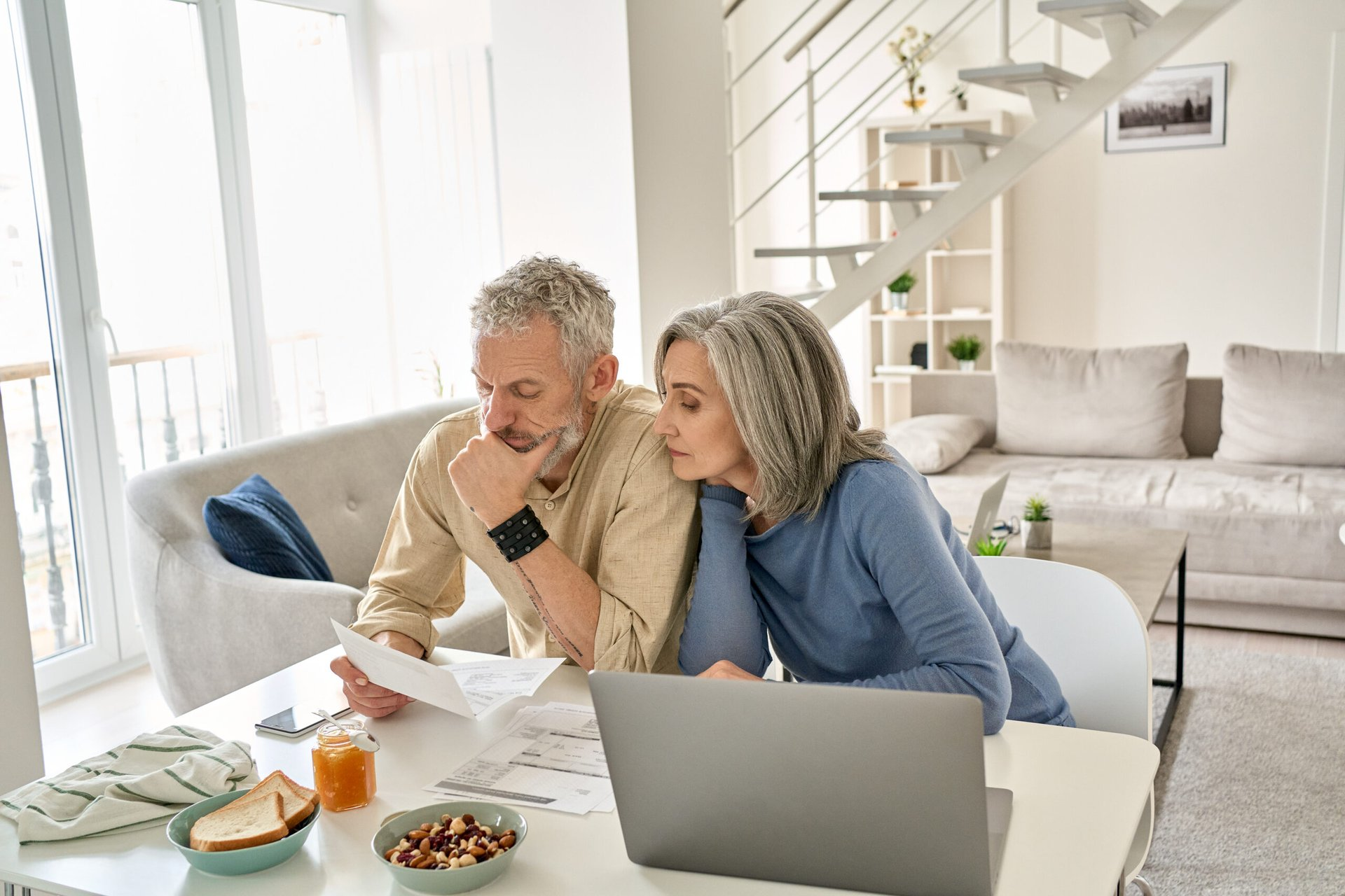 Worried retirees reviewing finances