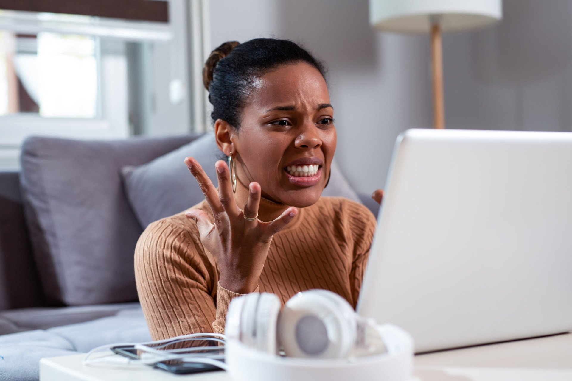 Upset woman using a laptop computer