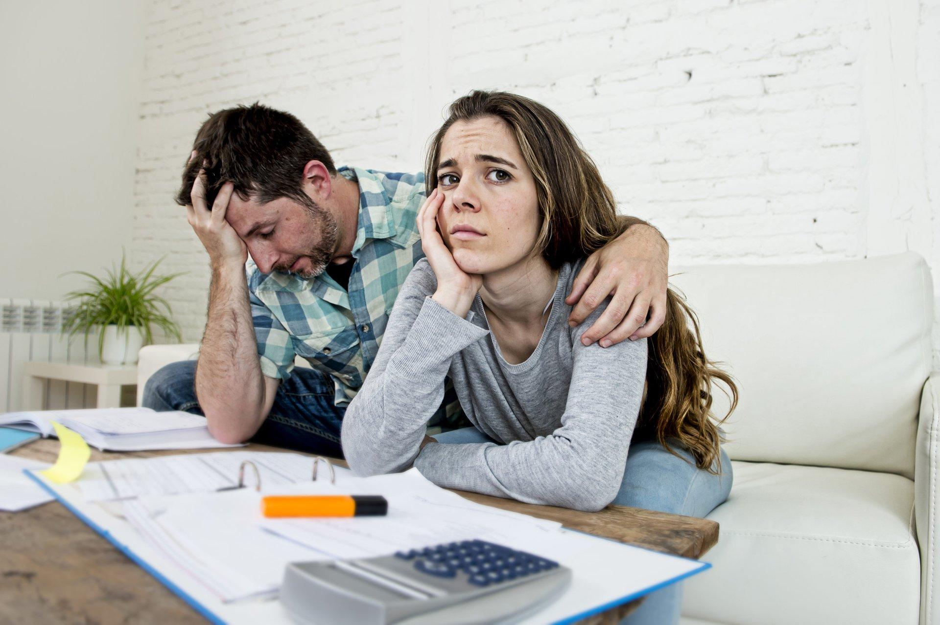 Sad couple with debt