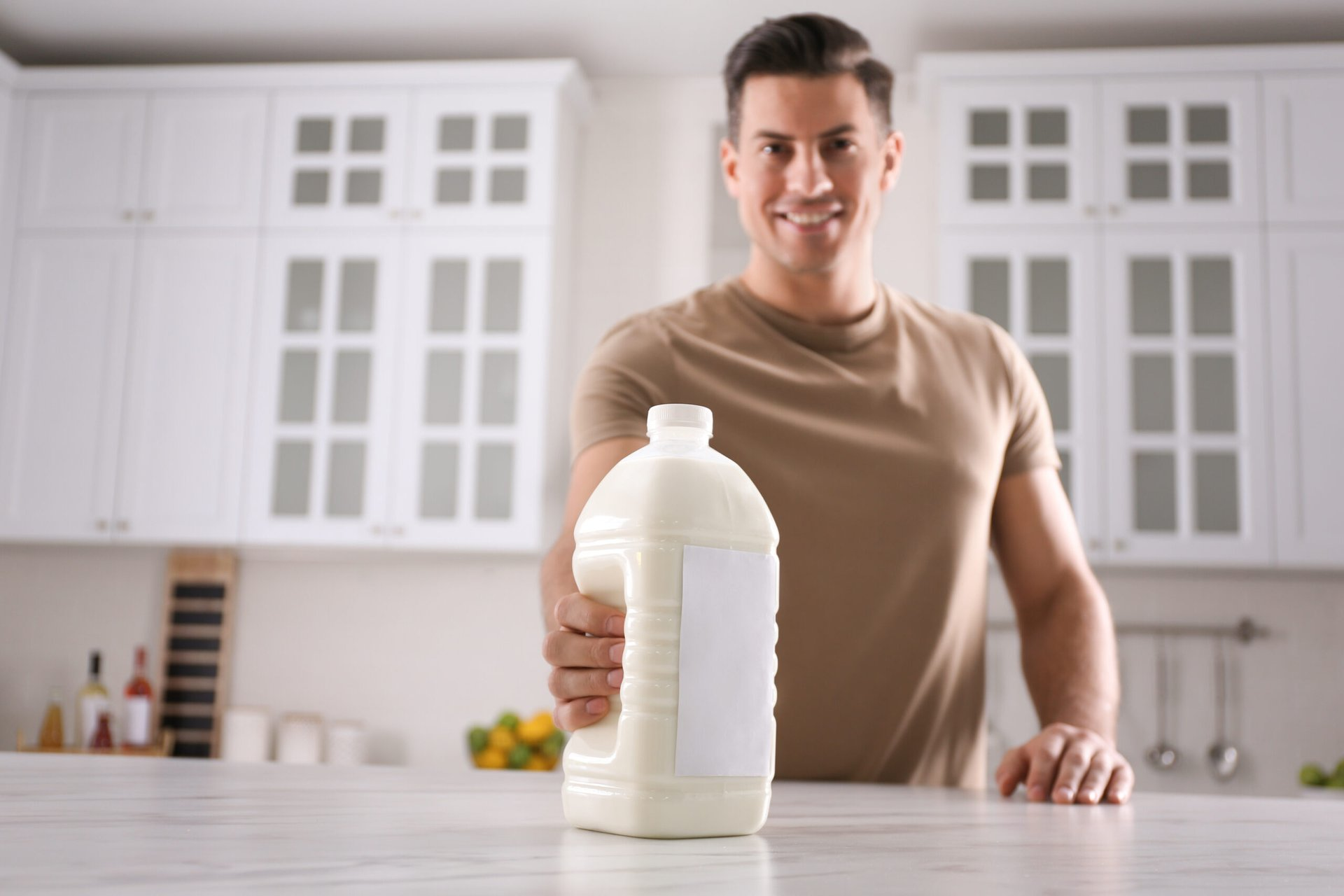 Man with a gallon of milk