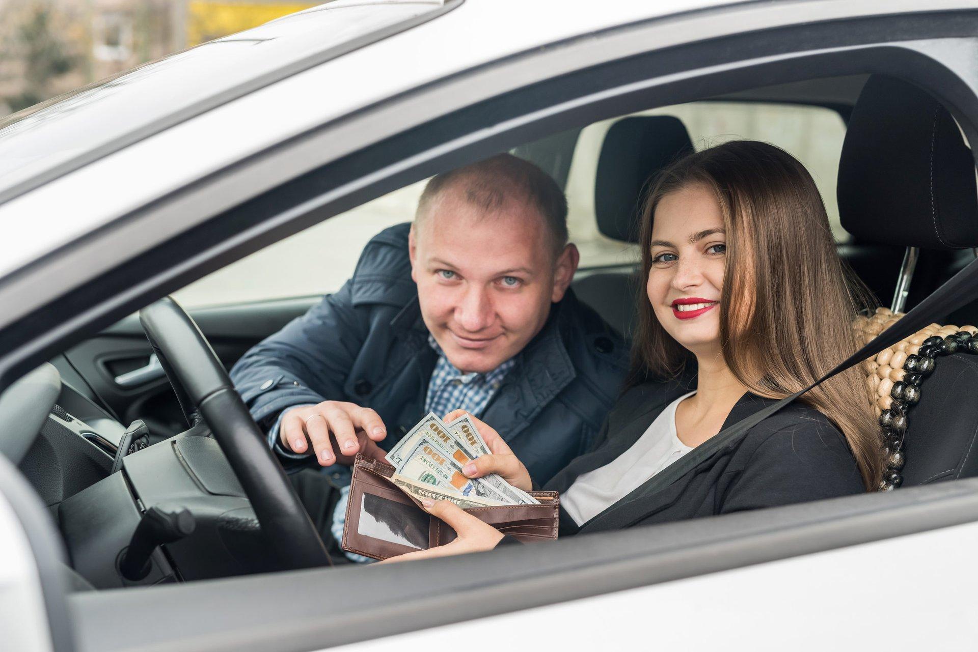 Driver saving money on used car