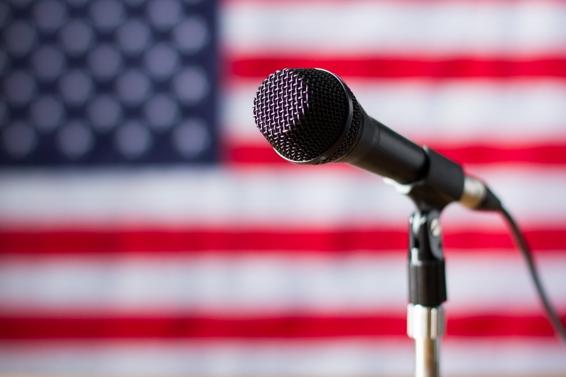 Microphone in front of a flag