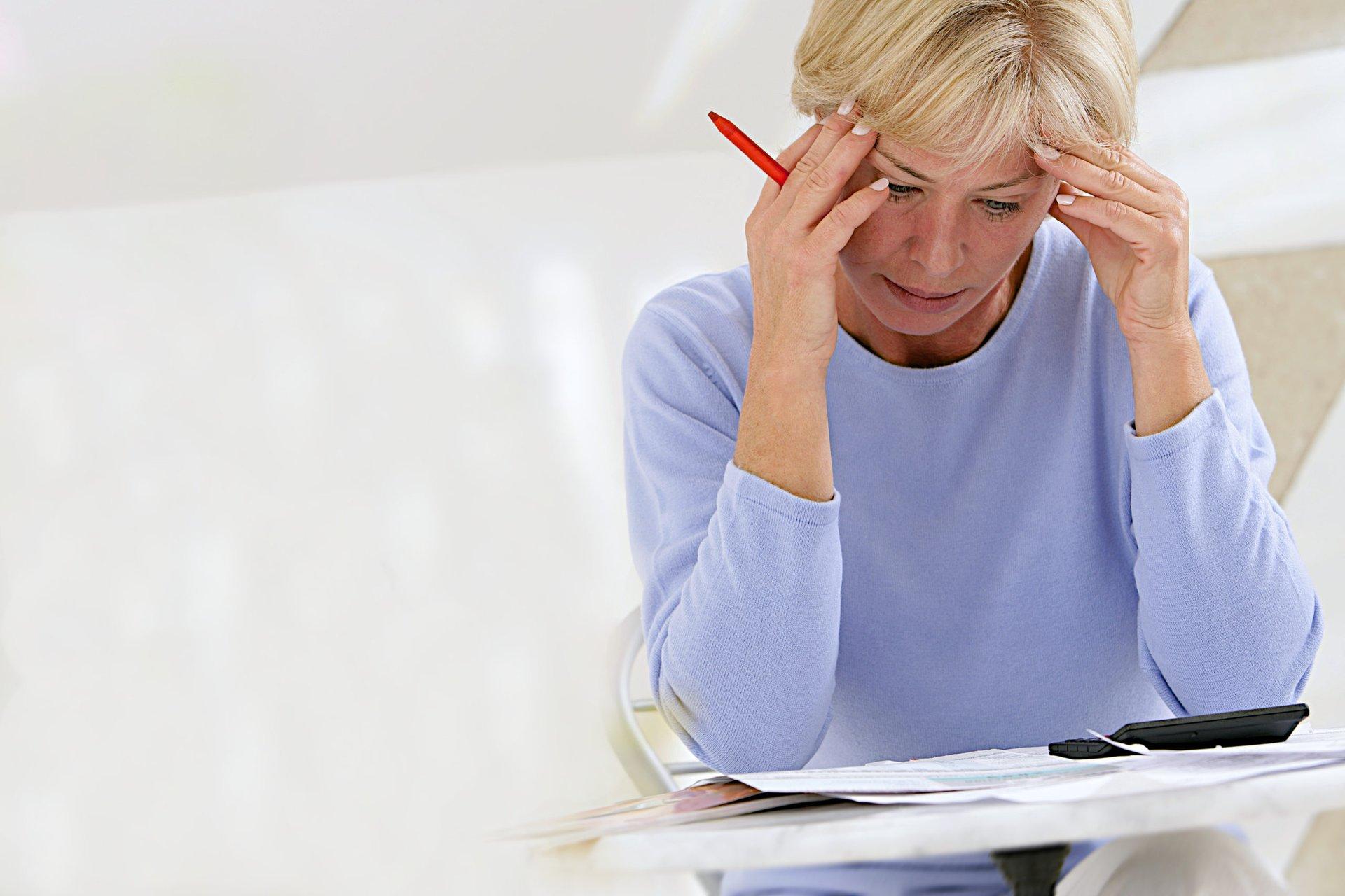 Stressed senior worried about bills