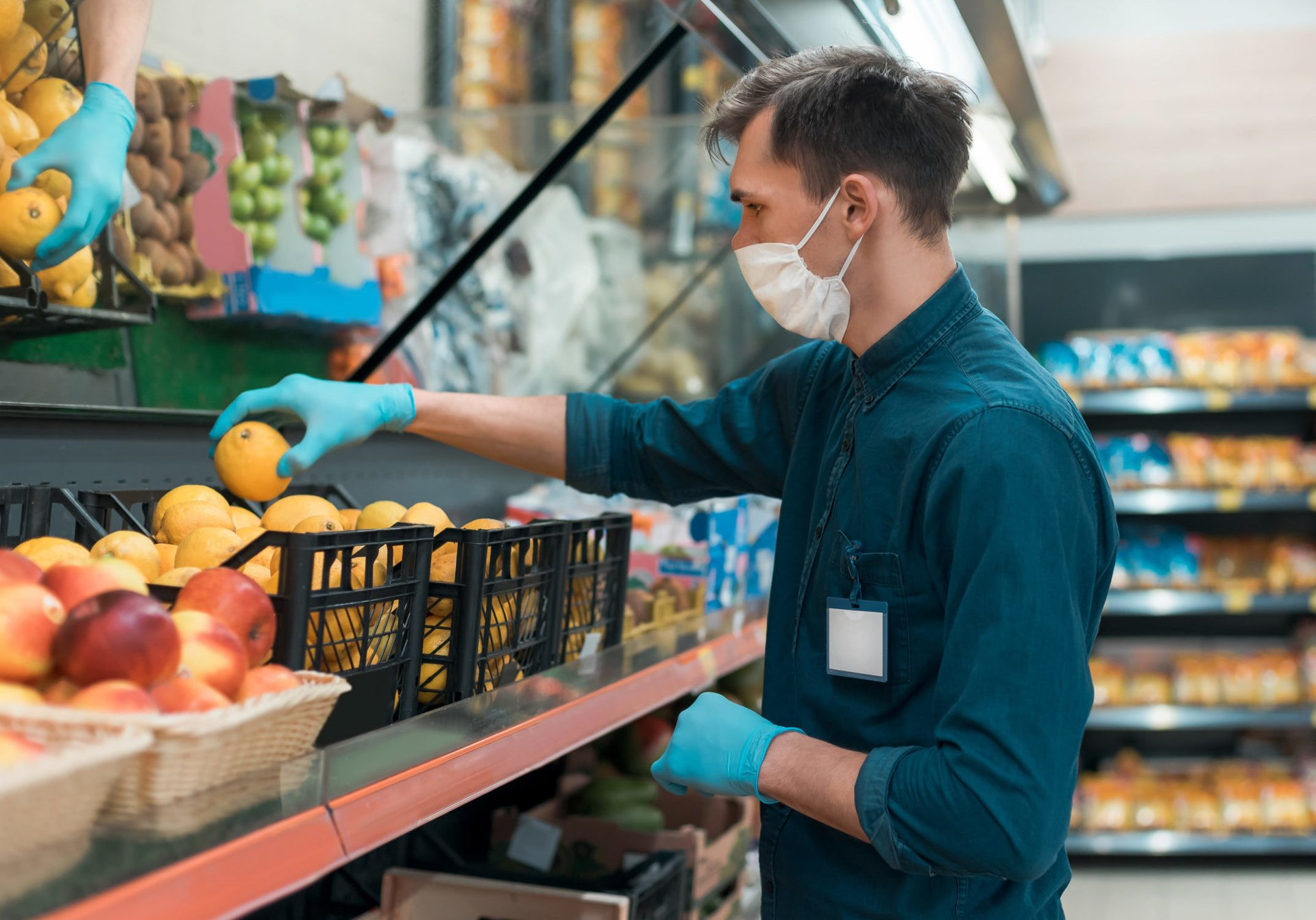 Grocery store worker in a mask